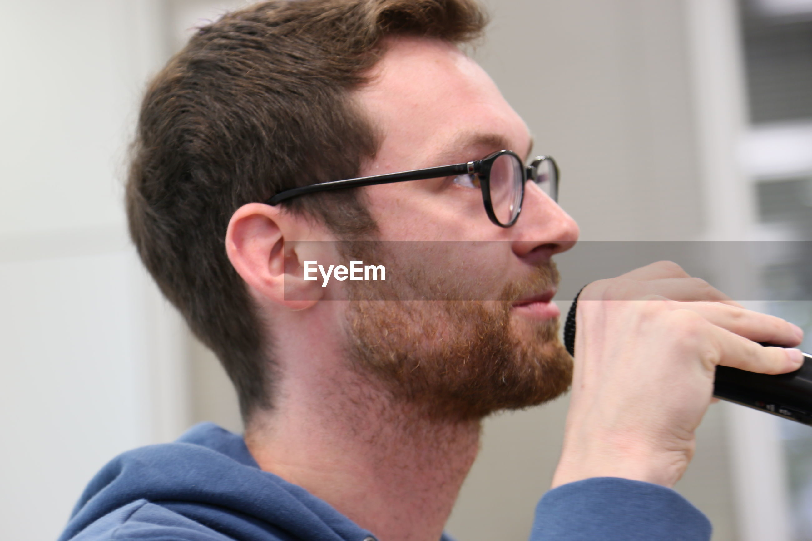 young adult, headshot, young men, person, lifestyles, portrait, front view, looking at camera, beard, focus on foreground, close-up, leisure activity, indoors, head and shoulders, serious, mid adult, mid adult men, handsome