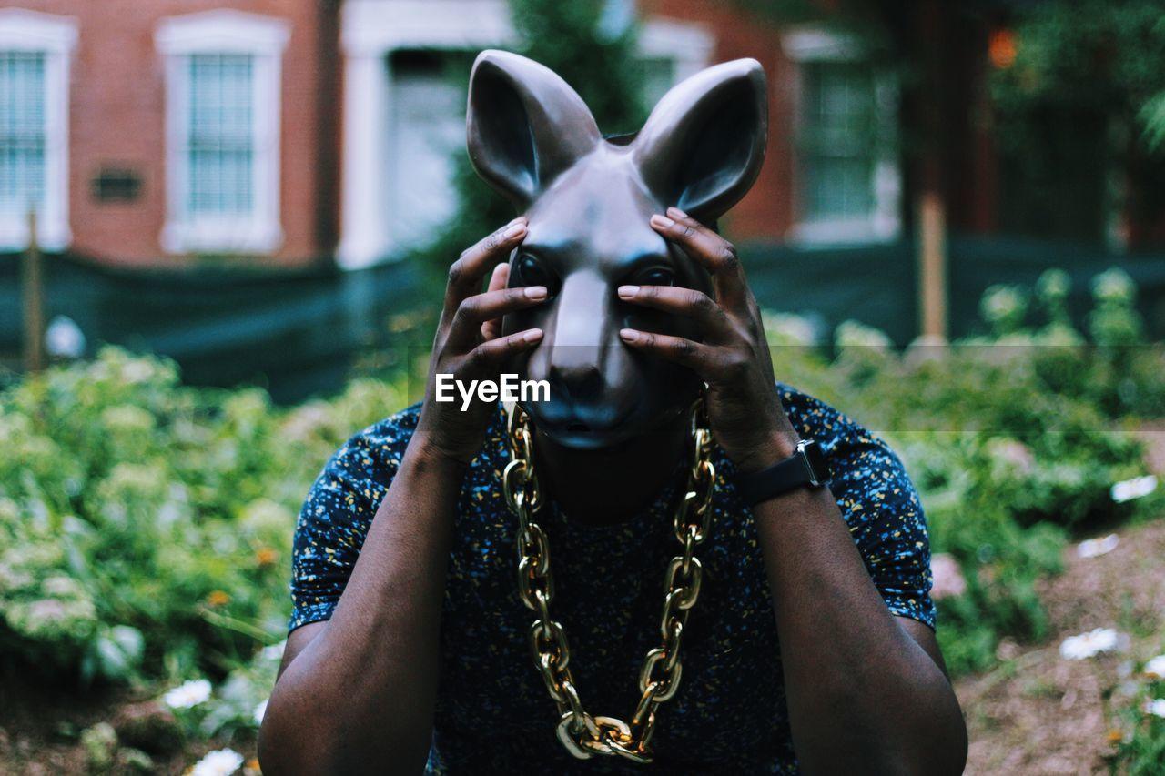 Man wearing rabbit mask
