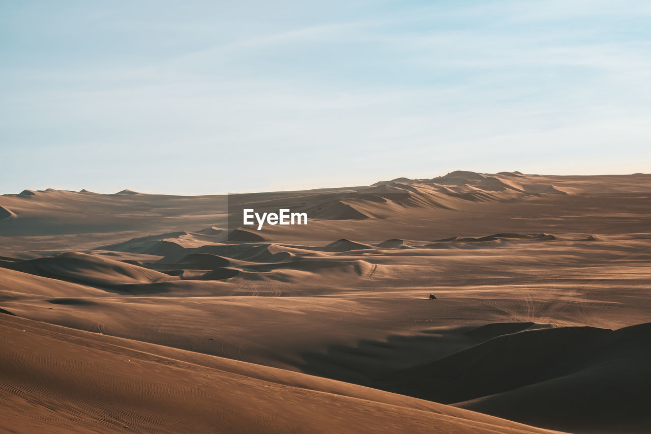 scenics - nature, landscape, desert, sky, environment, tranquil scene, beauty in nature, non-urban scene, climate, tranquility, arid climate, sand dune, no people, physical geography, land, remote, sand, nature, idyllic, cloud - sky, outdoors, rolling landscape, eroded