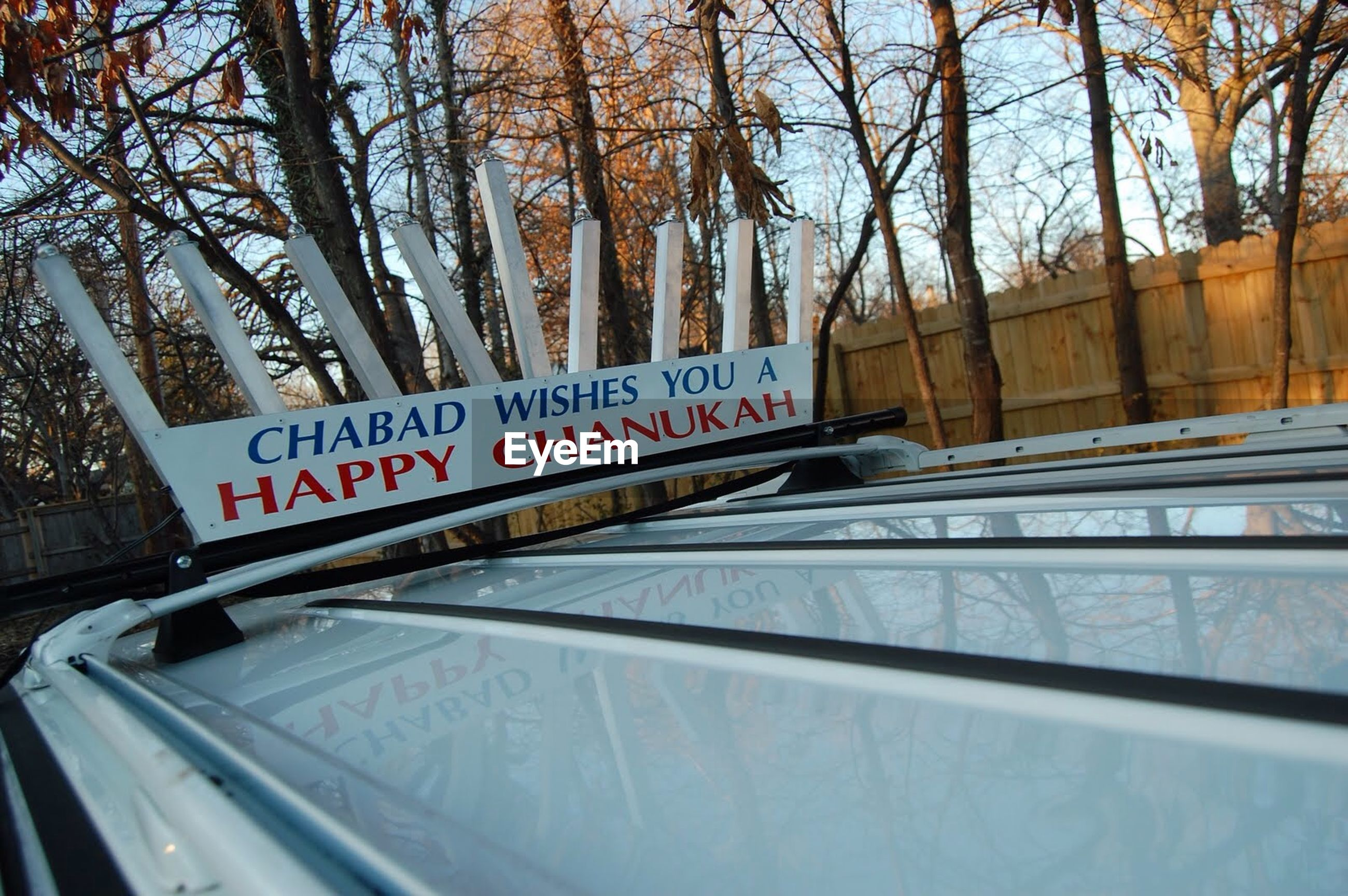 Low angle view of text on car roofrack