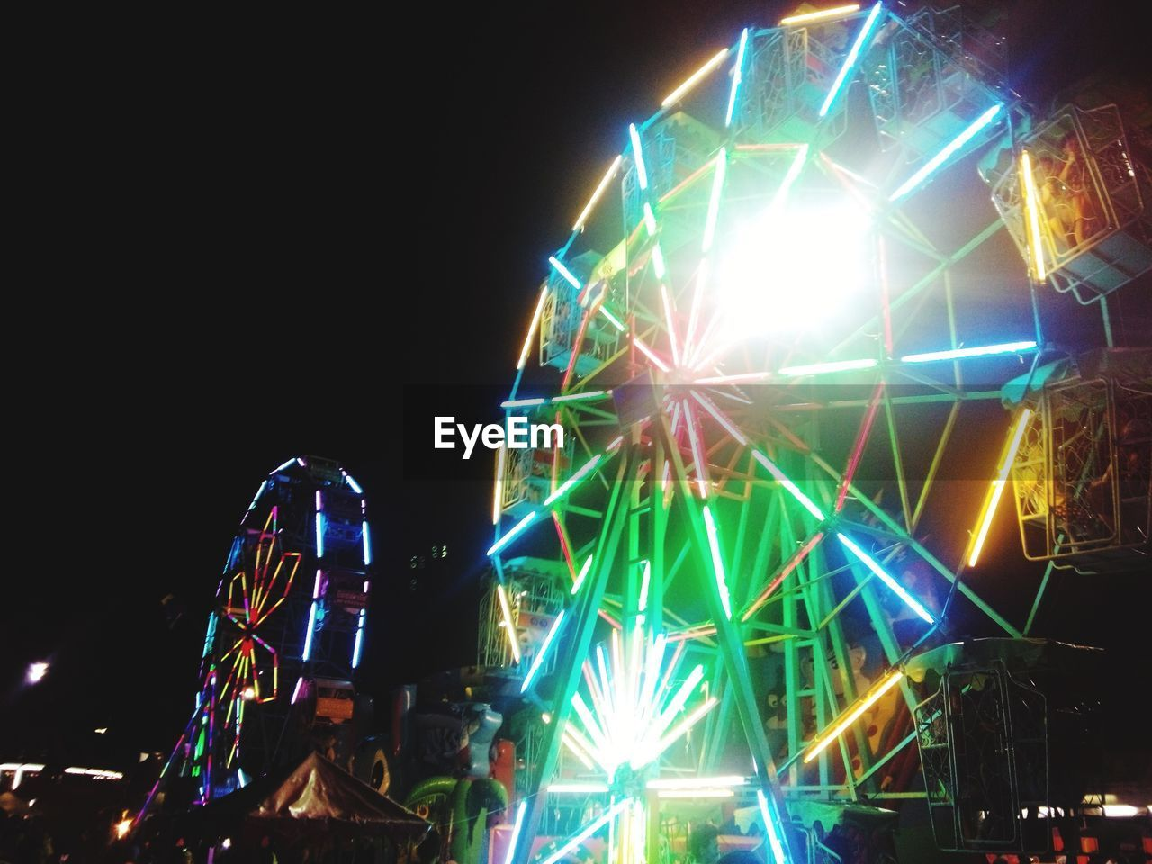 arts culture and entertainment, night, illuminated, amusement park, nightlife, fun, low angle view, leisure activity, enjoyment, amusement park ride, outdoors, no people, popular music concert, sky