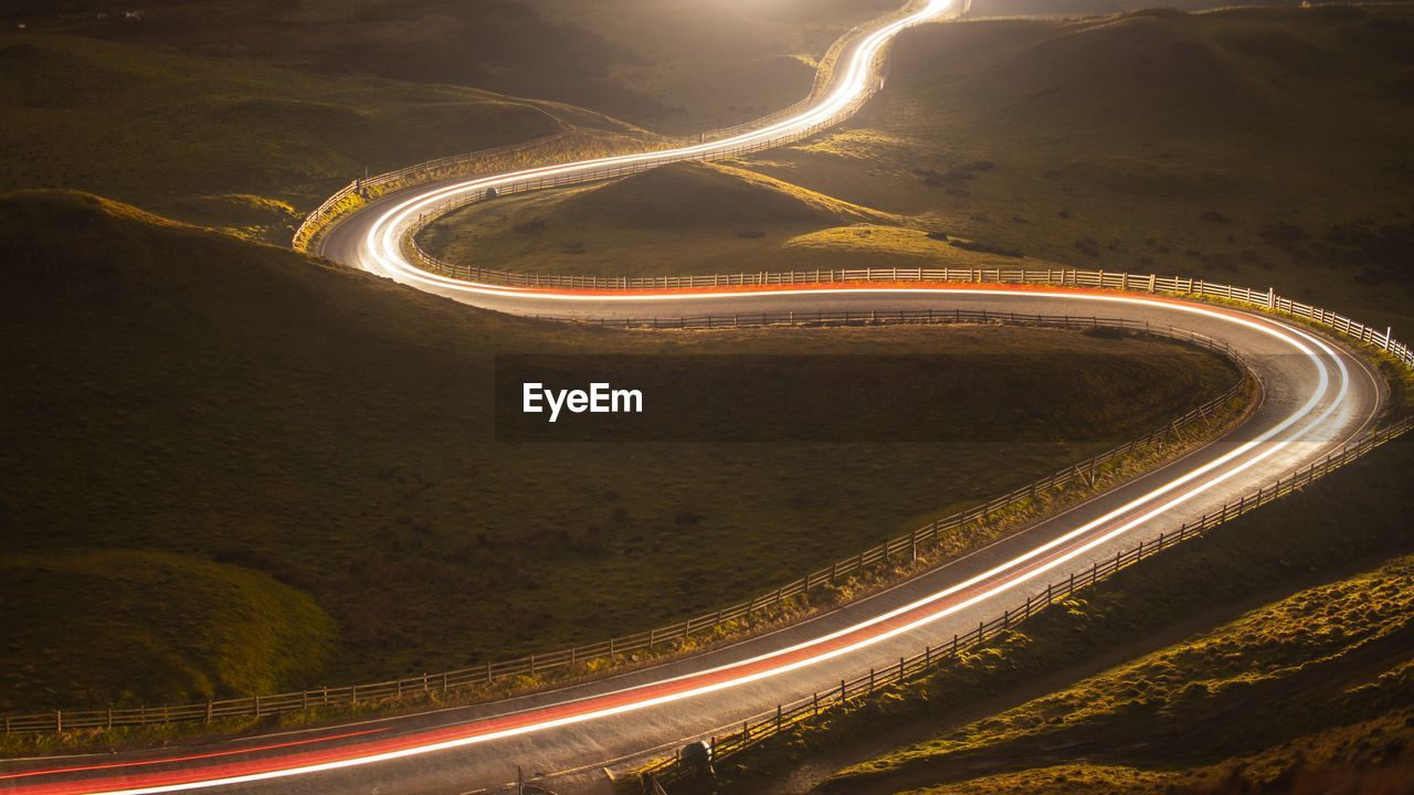 High angle view of light trails on road
