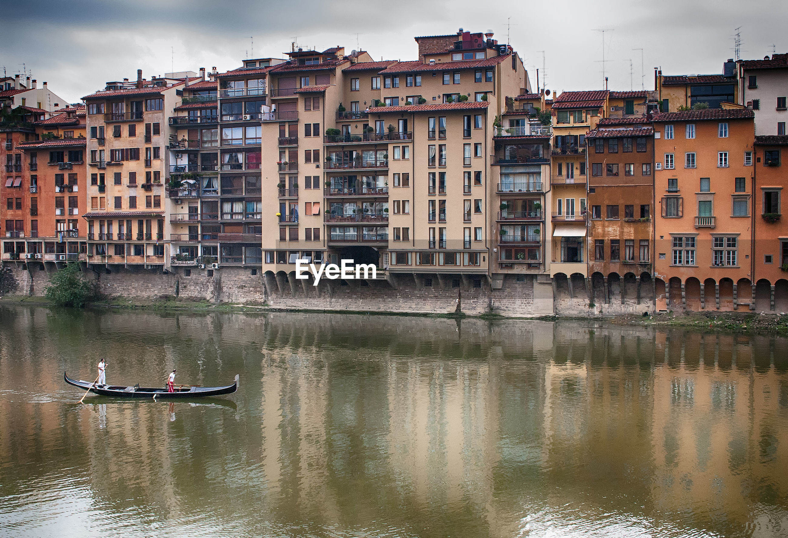 Boats in canal with buildings in background