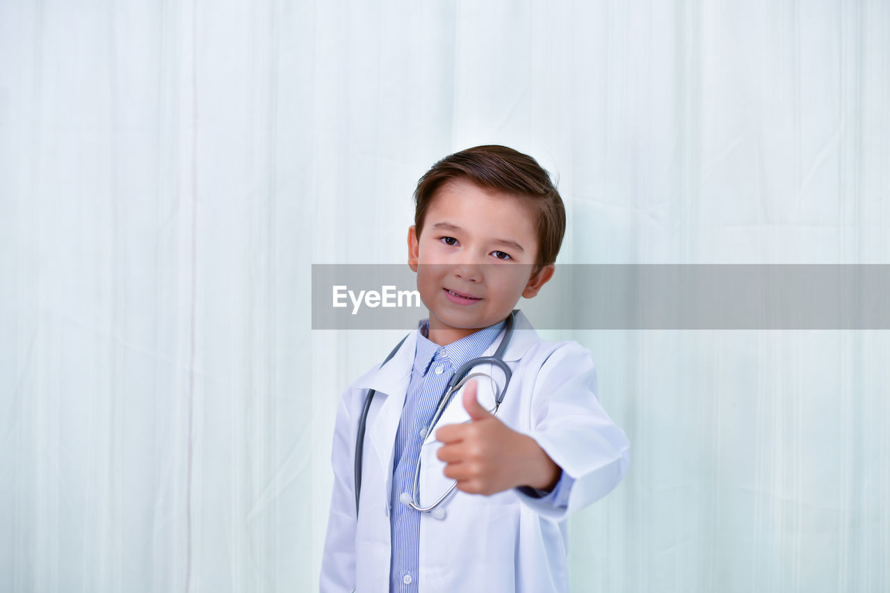 childhood, child, one person, portrait, looking at camera, front view, boys, indoors, standing, males, real people, clothing, waist up, men, innocence, curtain, doctor, lab coat, menswear