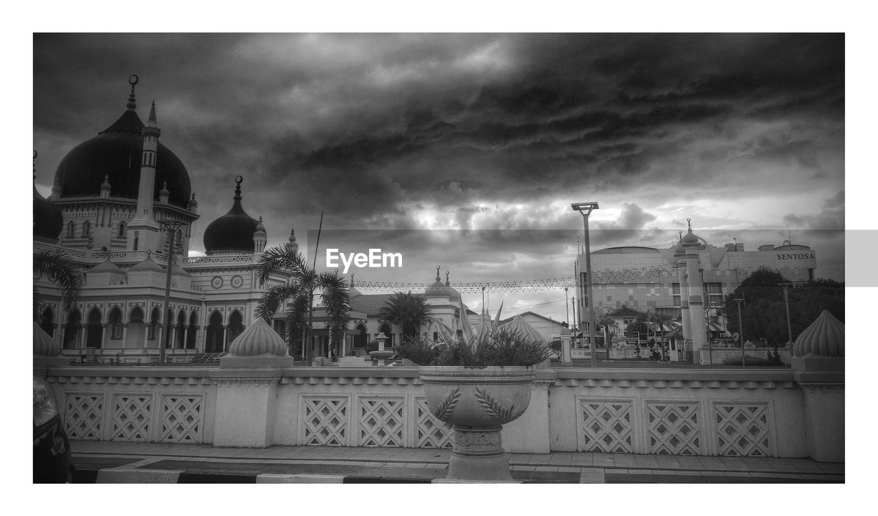 Low Angle View Of Zahir Mosque Against Cloudy Sky At Dusk