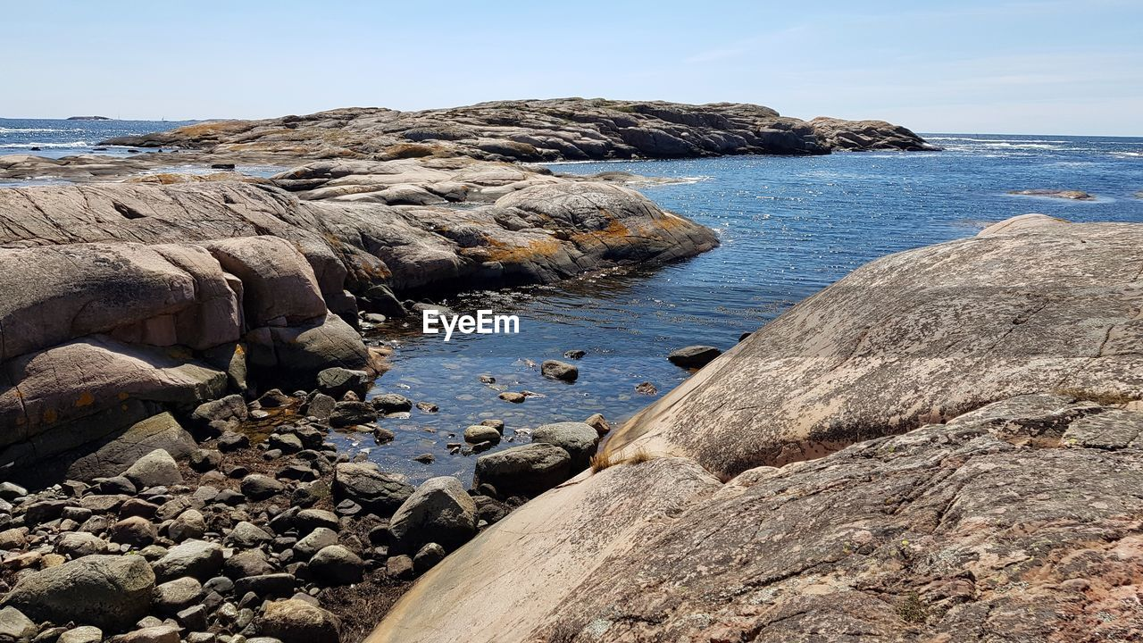 rock, water, rock - object, solid, sea, beauty in nature, sky, scenics - nature, beach, land, nature, tranquility, day, tranquil scene, no people, rock formation, non-urban scene, outdoors, idyllic, rocky coastline, eroded