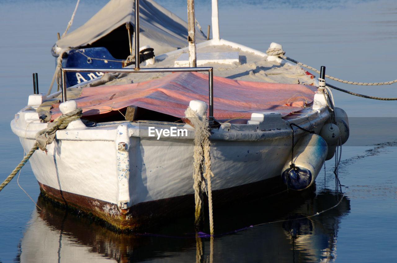 Fishing boat moored on lake
