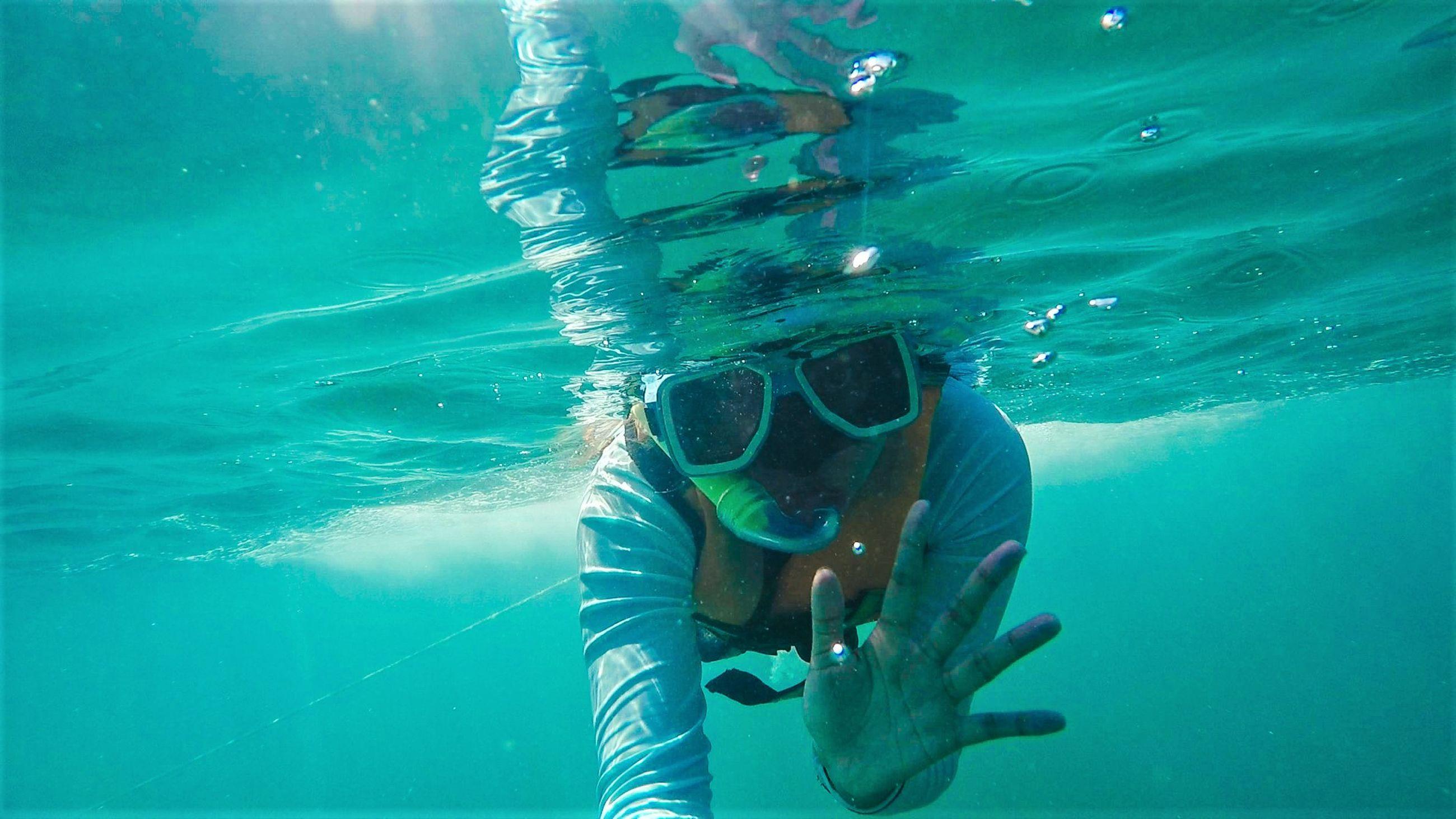 Portrait of person scuba diving in sea