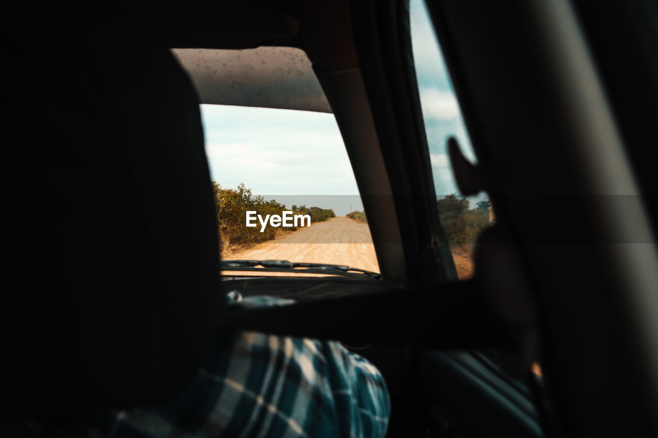 Cropped Image Of Person In Car
