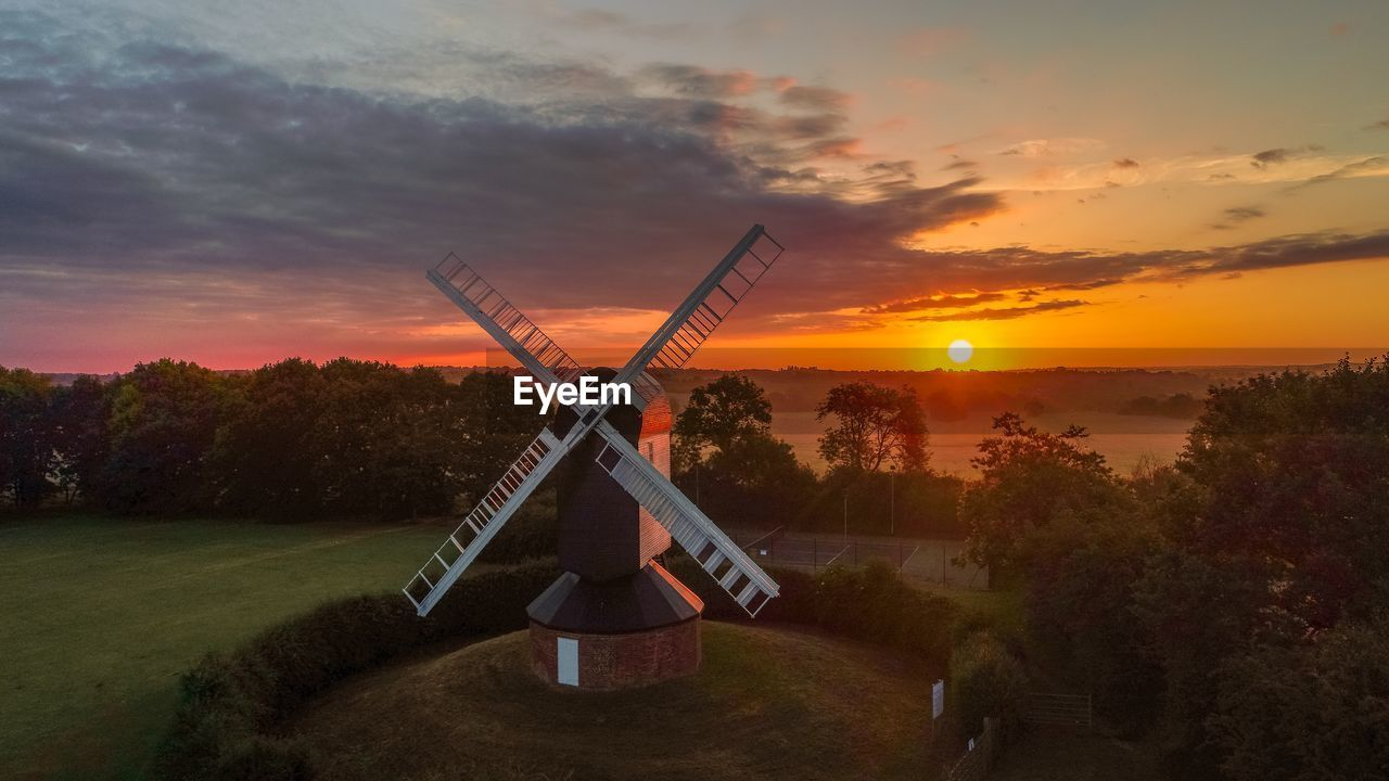 sunset, sky, cloud - sky, tree, orange color, plant, nature, beauty in nature, scenics - nature, renewable energy, environment, alternative energy, field, fuel and power generation, no people, environmental conservation, land, wind turbine, wind power, sun, outdoors