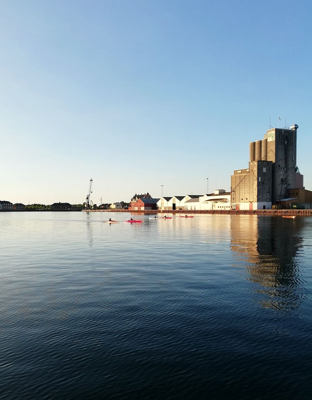 water, sky, architecture, waterfront, built structure, building exterior, clear sky, copy space, nature, no people, river, building, reflection, city, beauty in nature, day, blue, outdoors, transportation, marina