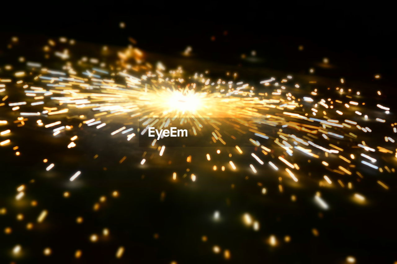 firework - man made object, firework display, sparks, exploding, night, glowing, long exposure, celebration, illuminated, motion, blurred motion, sparkler, arts culture and entertainment, event, burning, firework, gold colored, no people, diwali, multi colored, outdoors, sky