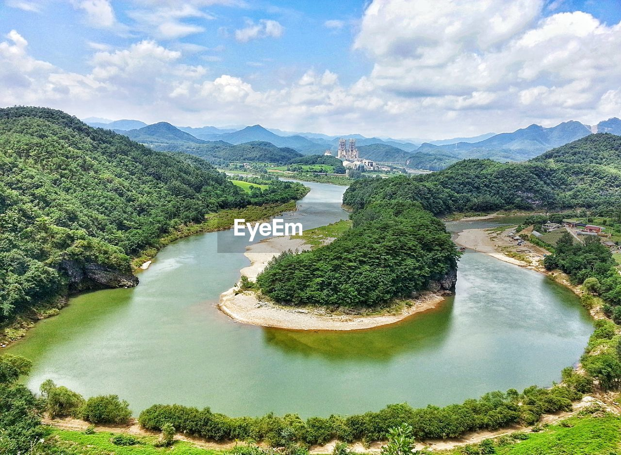 High Angle View Of River Against Cloudy Sky