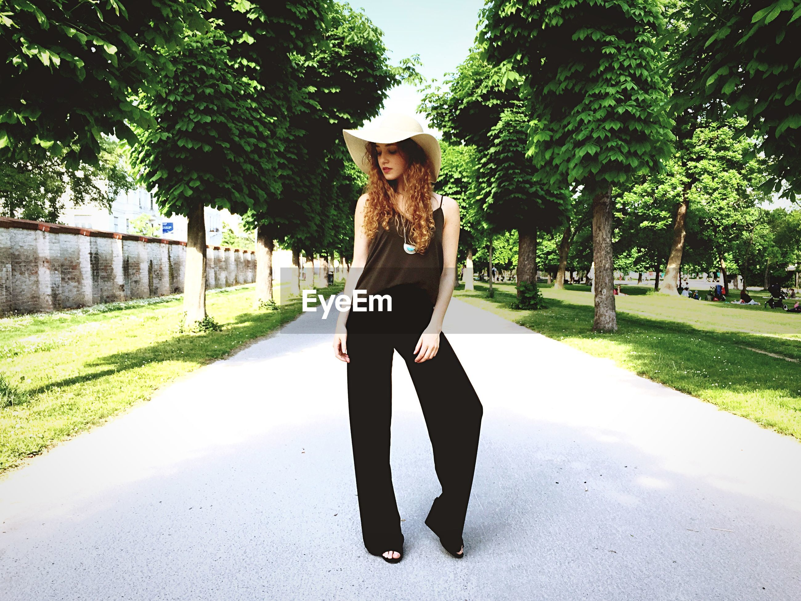 Full length of beautiful woman standing on road