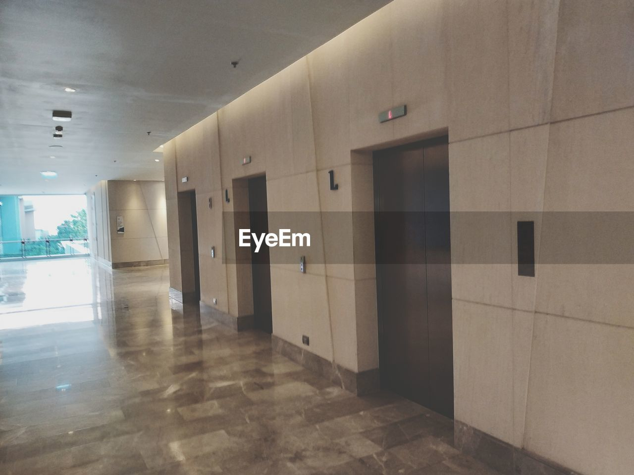 flooring, indoors, architecture, built structure, building, ceiling, arcade, tile, corridor, wall - building feature, no people, empty, entrance, door, absence, illuminated, tiled floor, wall, day, window, clean