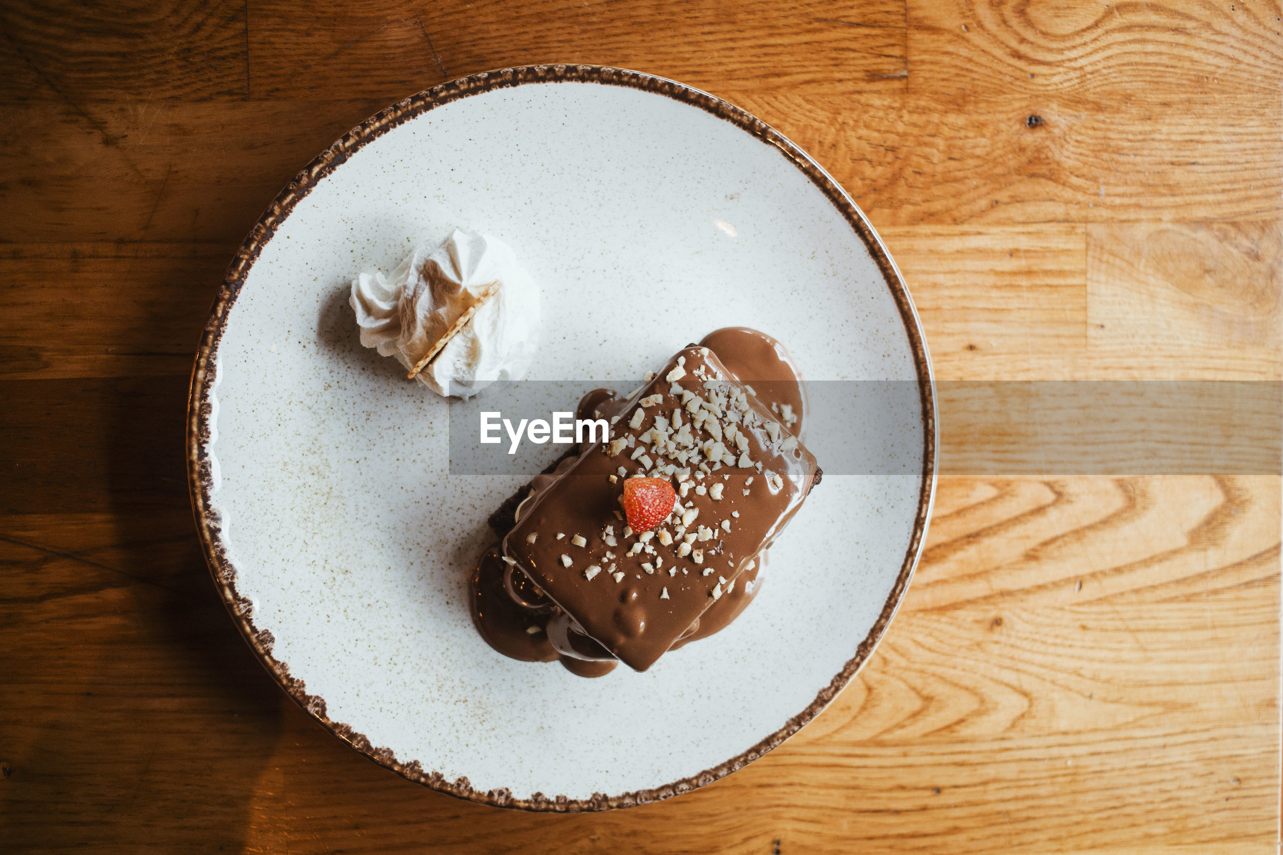 High angle view of dessert in plate on wooden table