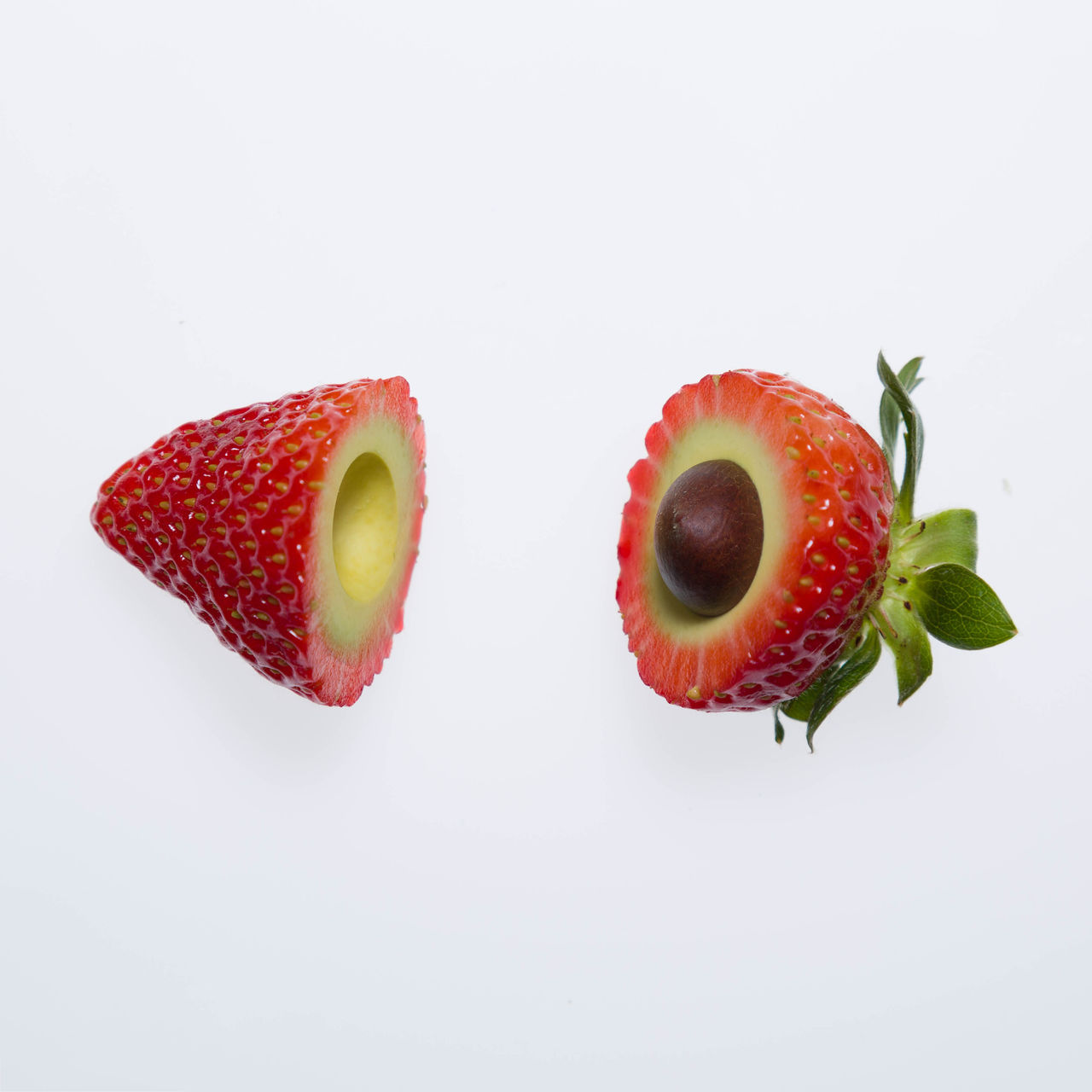 white background, studio shot, food and drink, food, healthy eating, fruit, freshness, still life, wellbeing, copy space, indoors, close-up, halved, cross section, cut out, no people, two objects, red, green color, slice, ripe, temptation