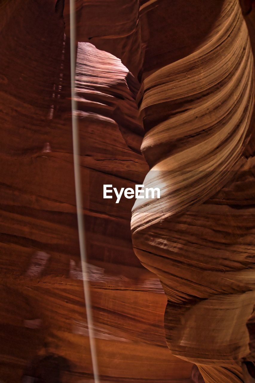 indoors, brown, no people, close-up, rock, low angle view, natural pattern, physical geography, rock formation, wood - material, pattern, rock - object, canyon, full frame, geology, day, solid, textured, nature, sandstone, eroded