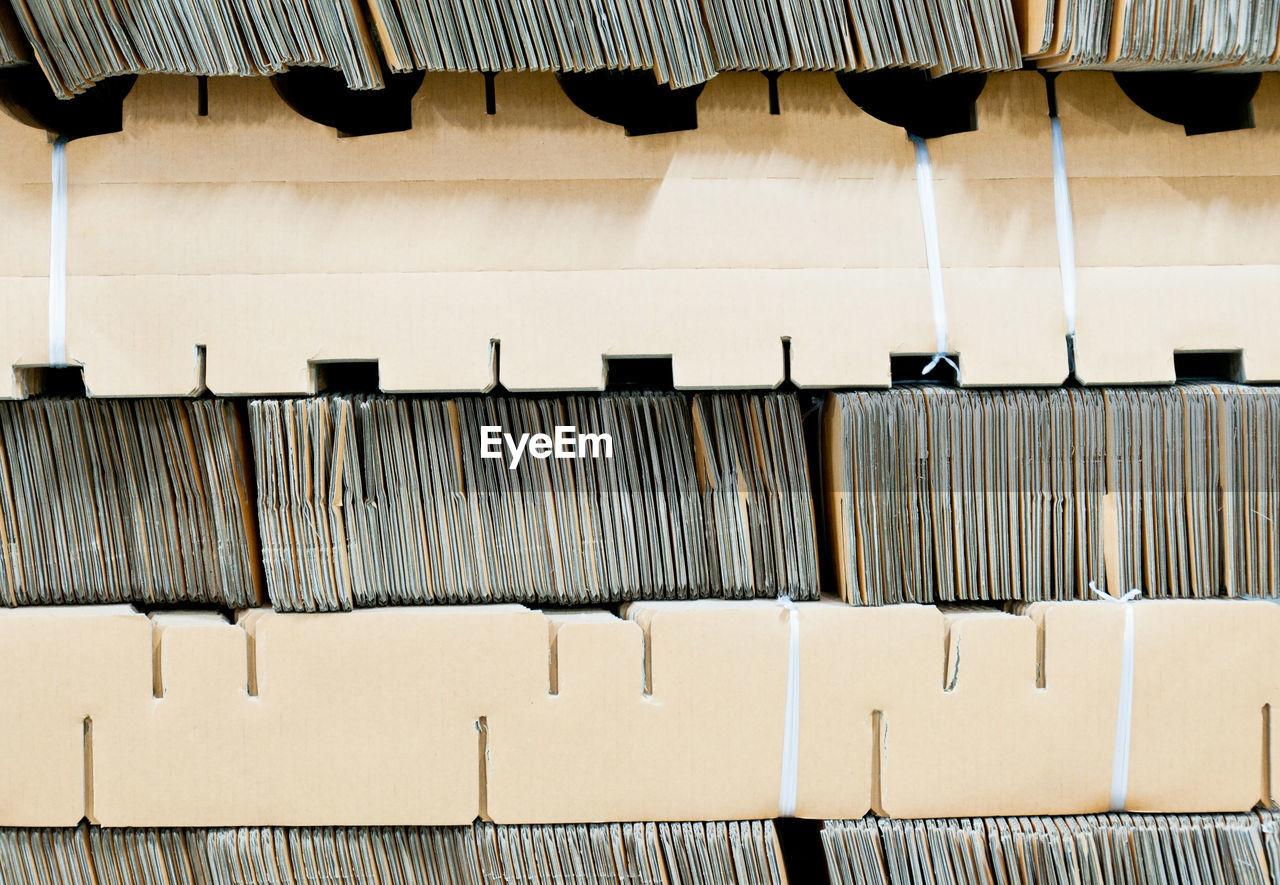 Full frame of cardboards arranged in shelves
