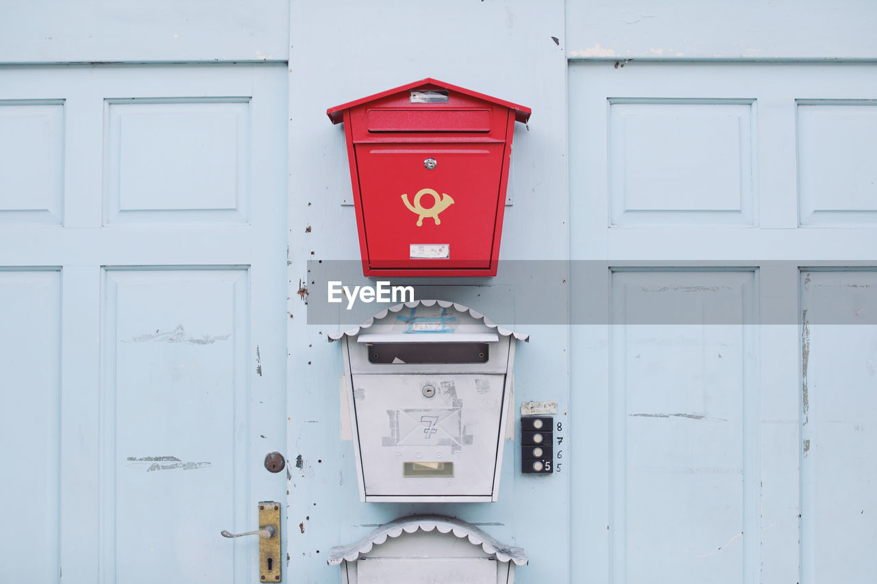 communication, wall - building feature, red, no people, built structure, mailbox, day, mail, security, safety, architecture, protection, technology, public mailbox, text, building exterior, fire alarm, connection, outdoors, convenience, cabin