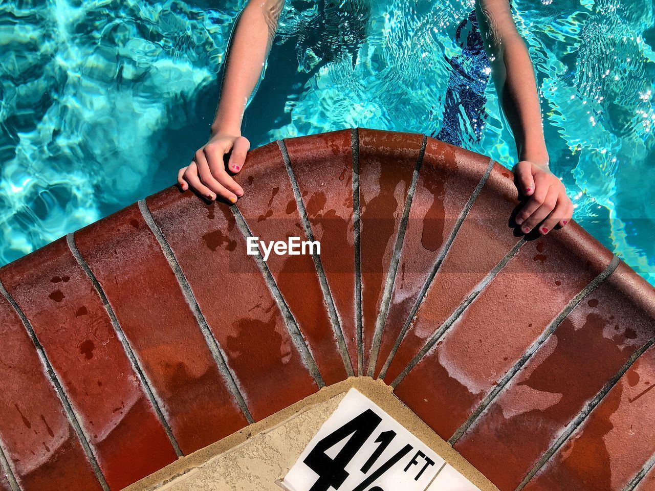 Cropped Hands In Swimming Pool