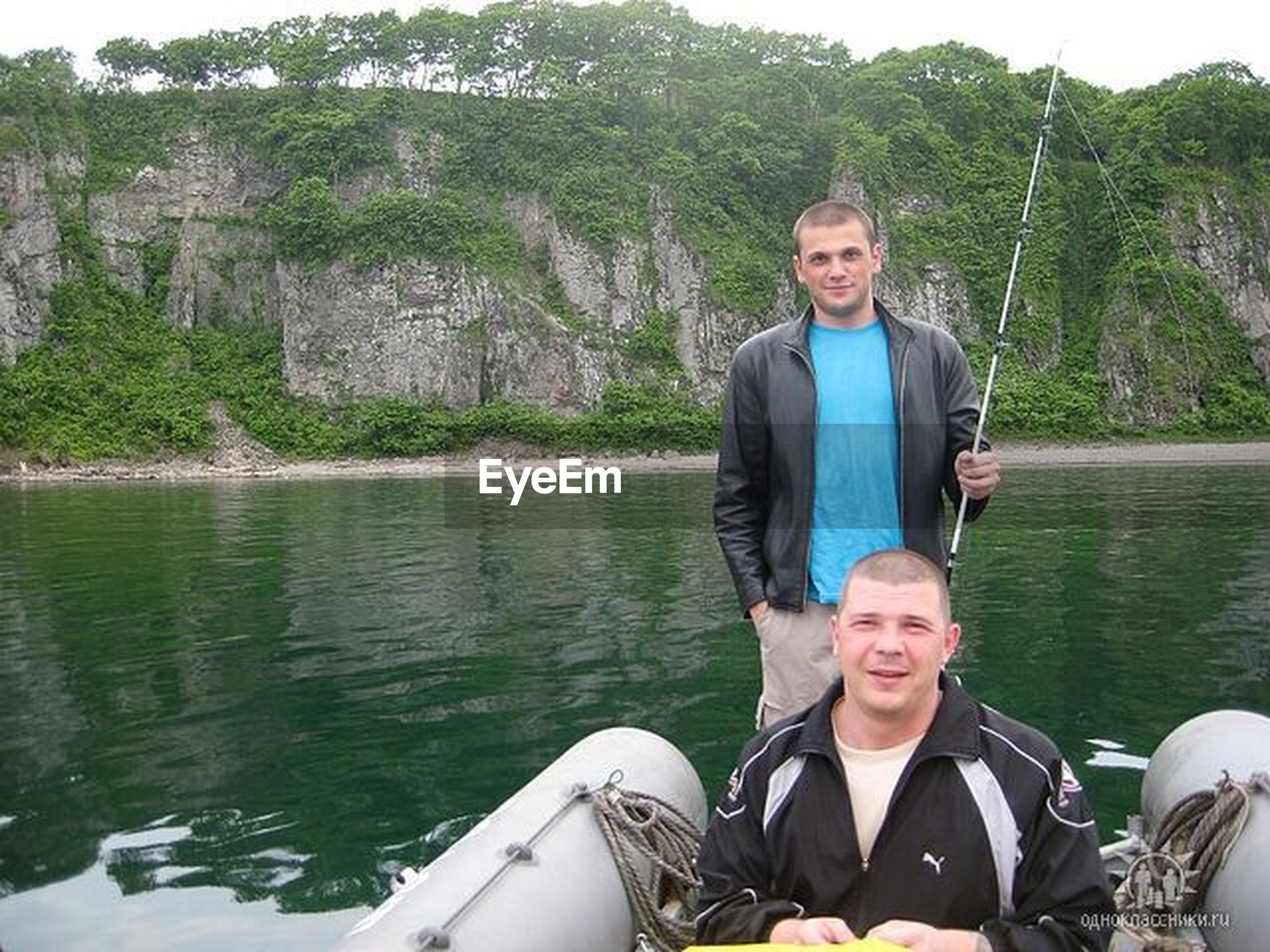 person, water, young adult, lifestyles, smiling, looking at camera, leisure activity, portrait, happiness, casual clothing, front view, young men, vacations, river, lake, enjoyment