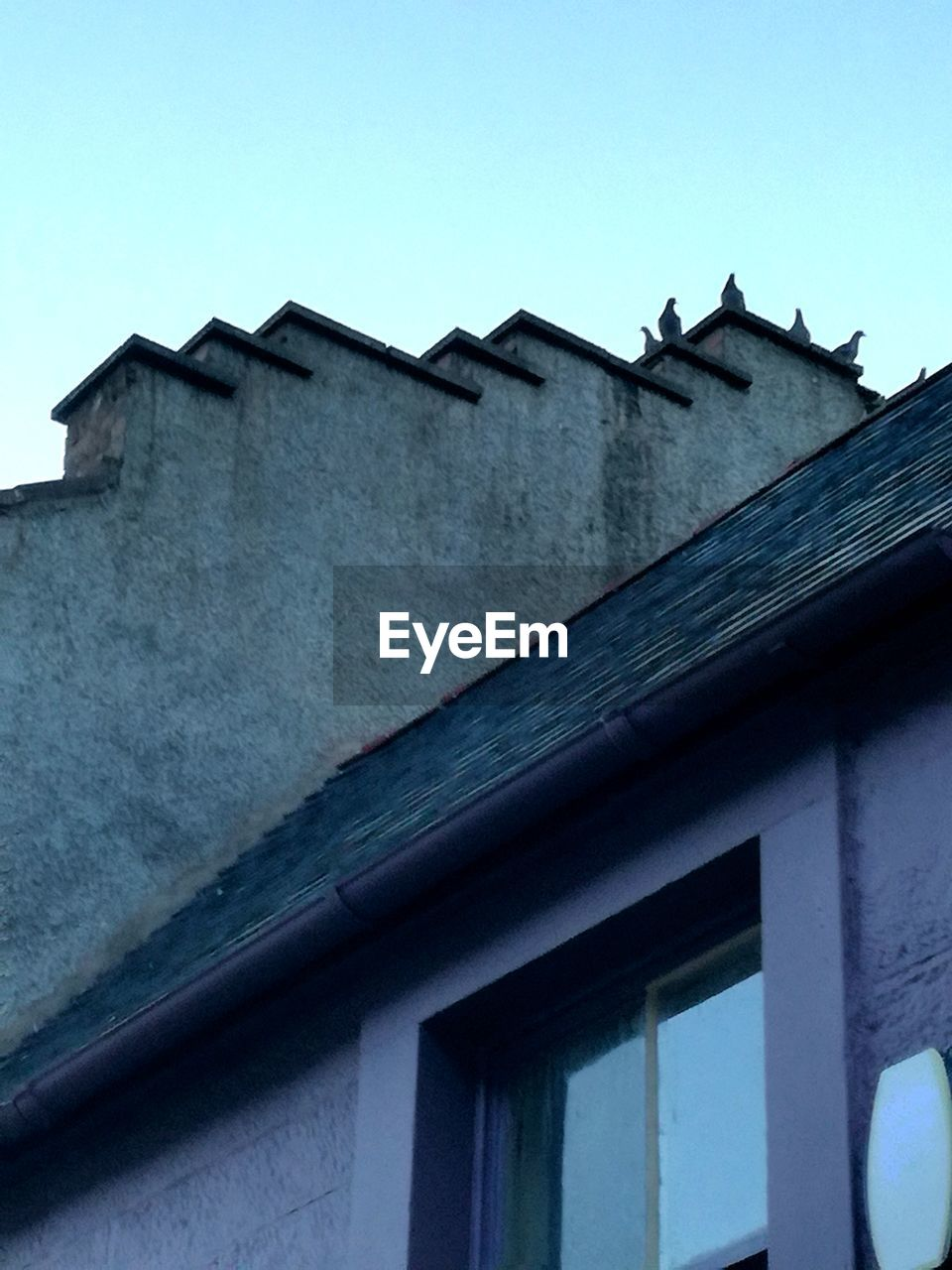 architecture, building exterior, built structure, sky, low angle view, building, window, house, no people, clear sky, day, roof, nature, residential district, outdoors, cold temperature, winter, blue, copy space, roof tile