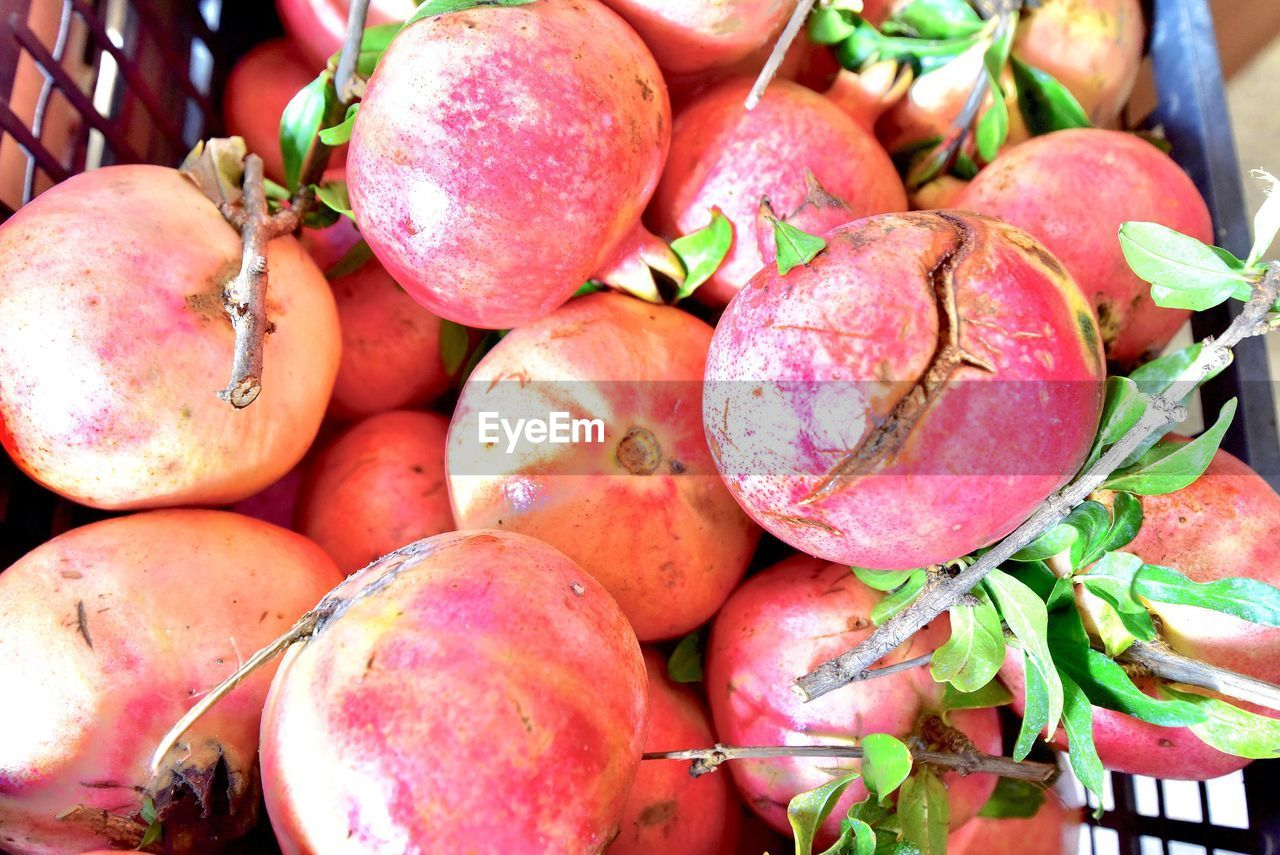 food, food and drink, healthy eating, wellbeing, freshness, fruit, large group of objects, close-up, no people, still life, market, abundance, day, for sale, market stall, pomegranate, retail, red, full frame, heap, ripe