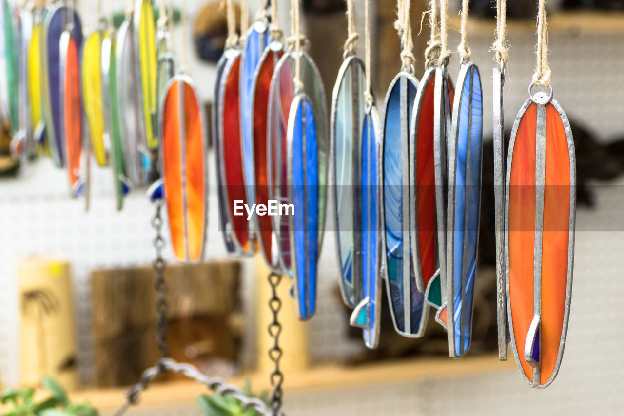 hanging, choice, variation, retail, indoors, for sale, side by side, large group of objects, multi colored, collection, close-up, no people, in a row, still life, store, order, market, arrangement, focus on foreground, selective focus, sale, retail display, consumerism