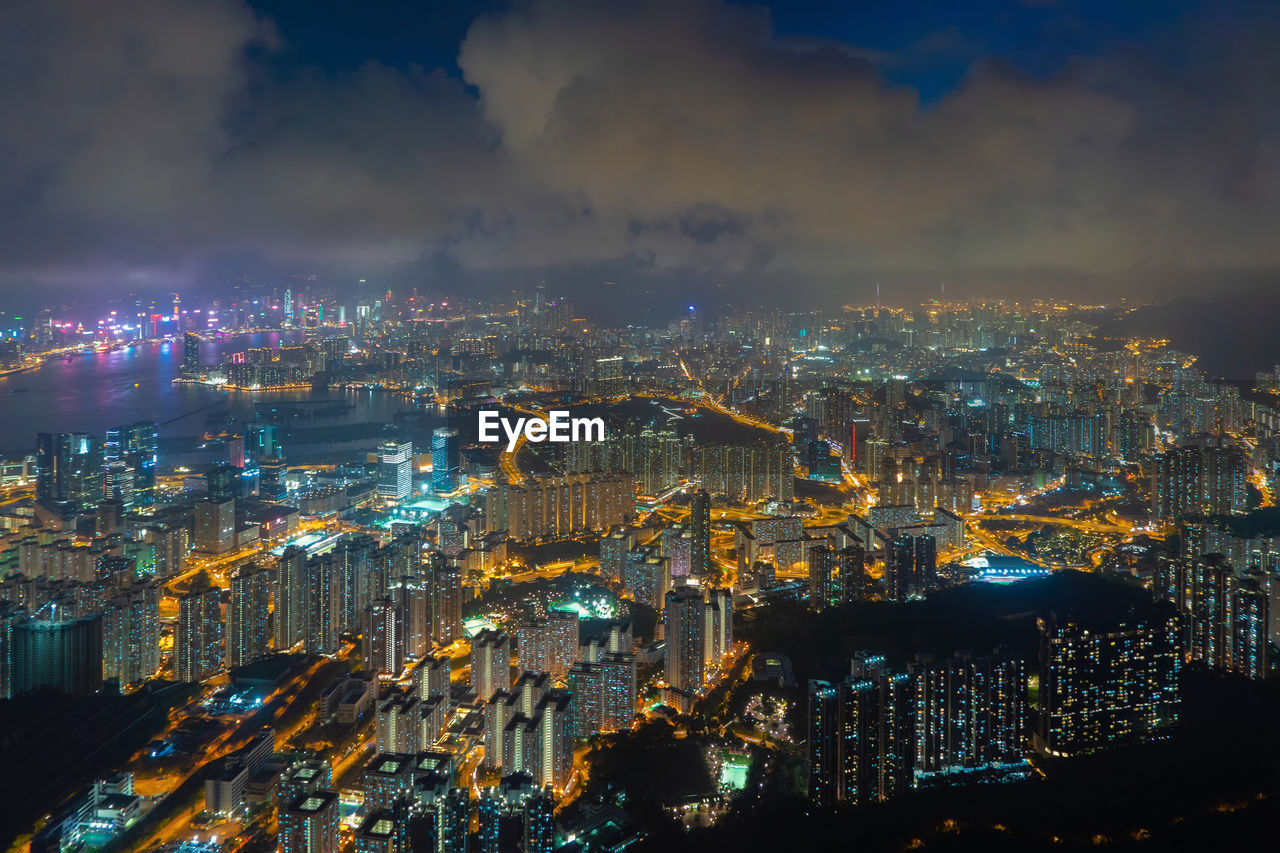 High angle view of illuminated cityscape against sky at night