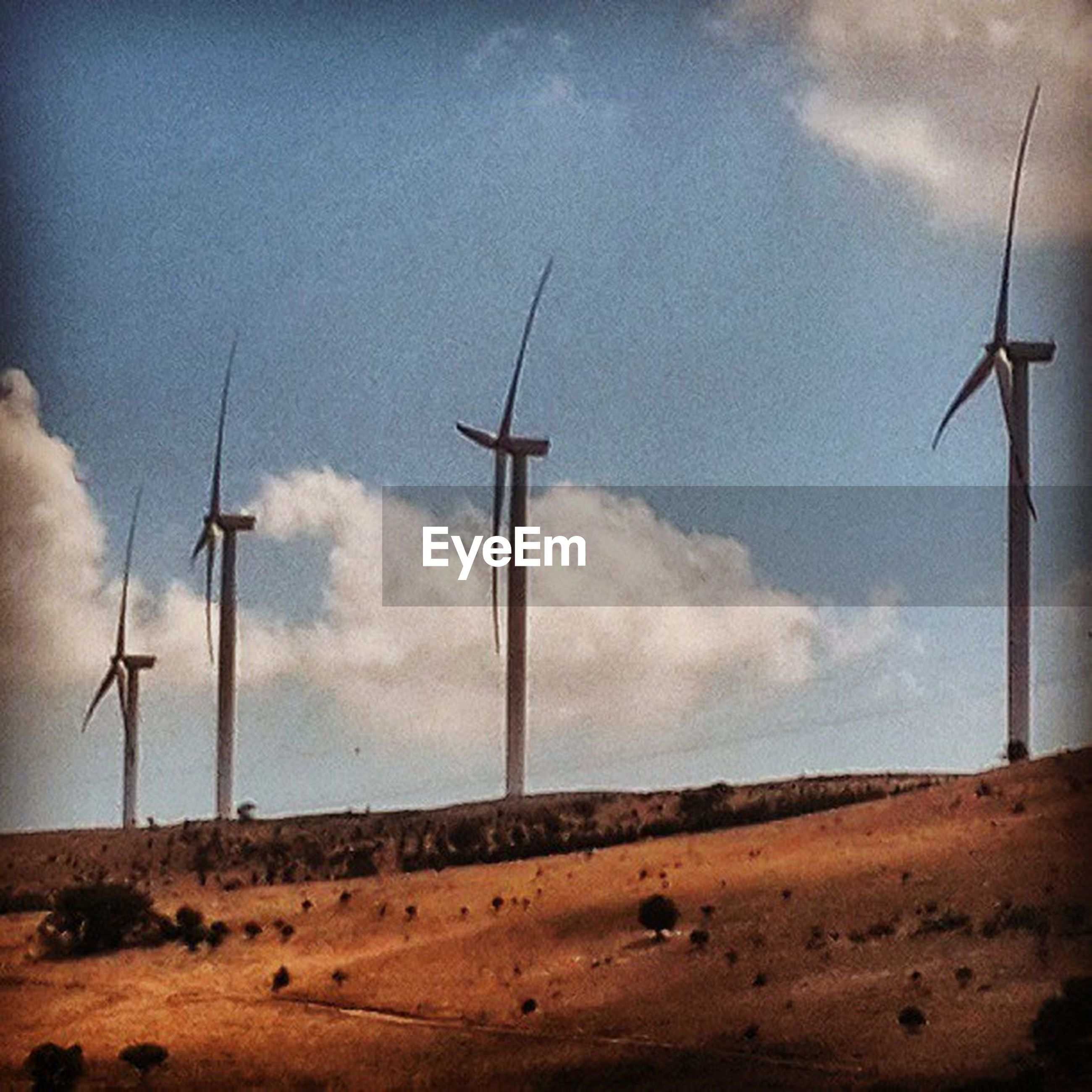 wind turbine, wind power, alternative energy, windmill, environmental conservation, renewable energy, sky, landscape, fuel and power generation, cloud - sky, field, rural scene, cloud, tranquil scene, technology, tranquility, low angle view, cloudy, traditional windmill, nature