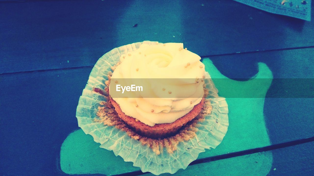food and drink, sweet food, food, indulgence, temptation, freshness, cake, dessert, unhealthy eating, cupcake, ready-to-eat, no people, table, high angle view, birthday cake, indoors, plate, close-up, day