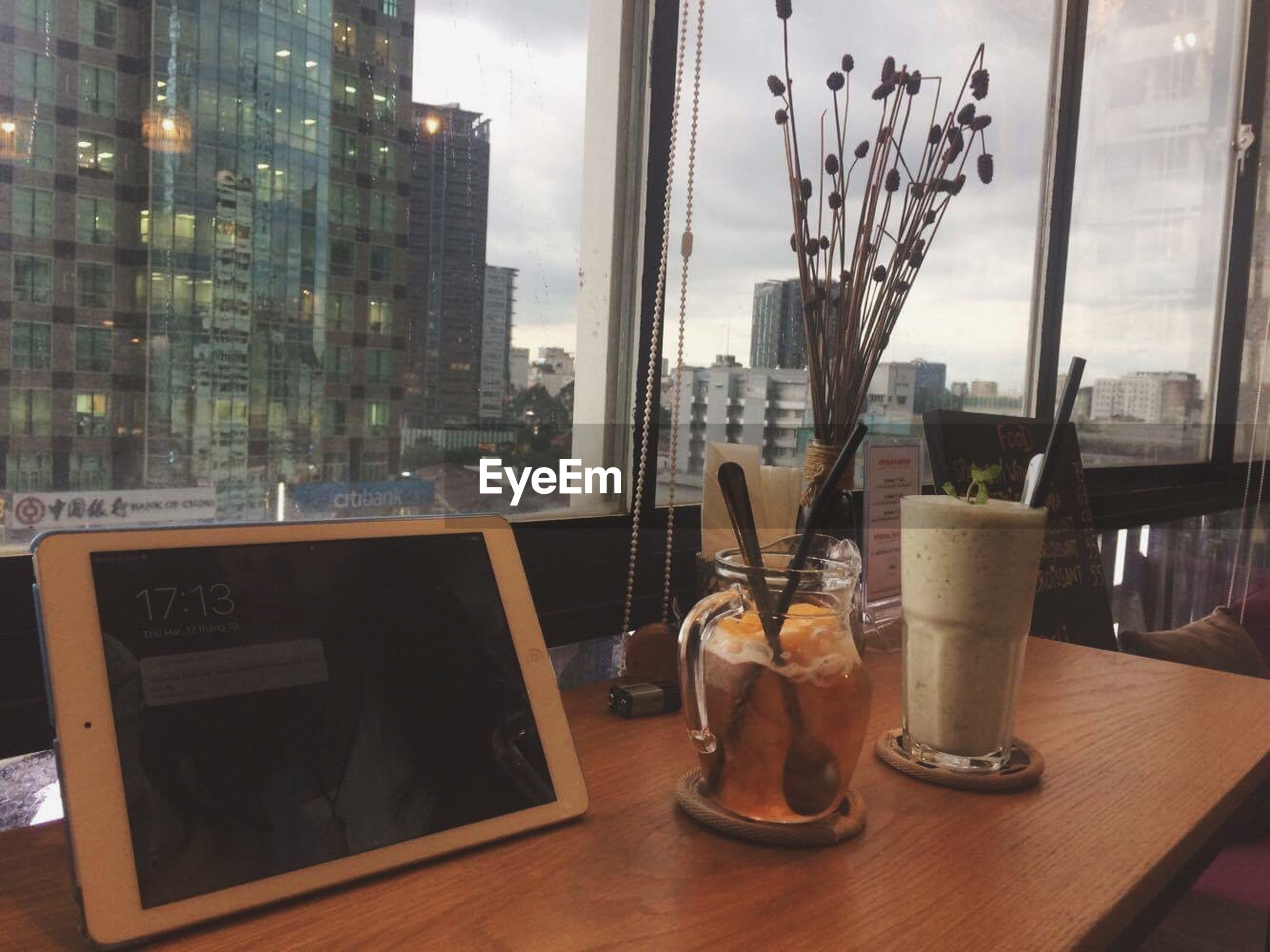 window, table, indoors, glass - material, still life, glass, architecture, modern, place of work, skyscraper, development, tall - high