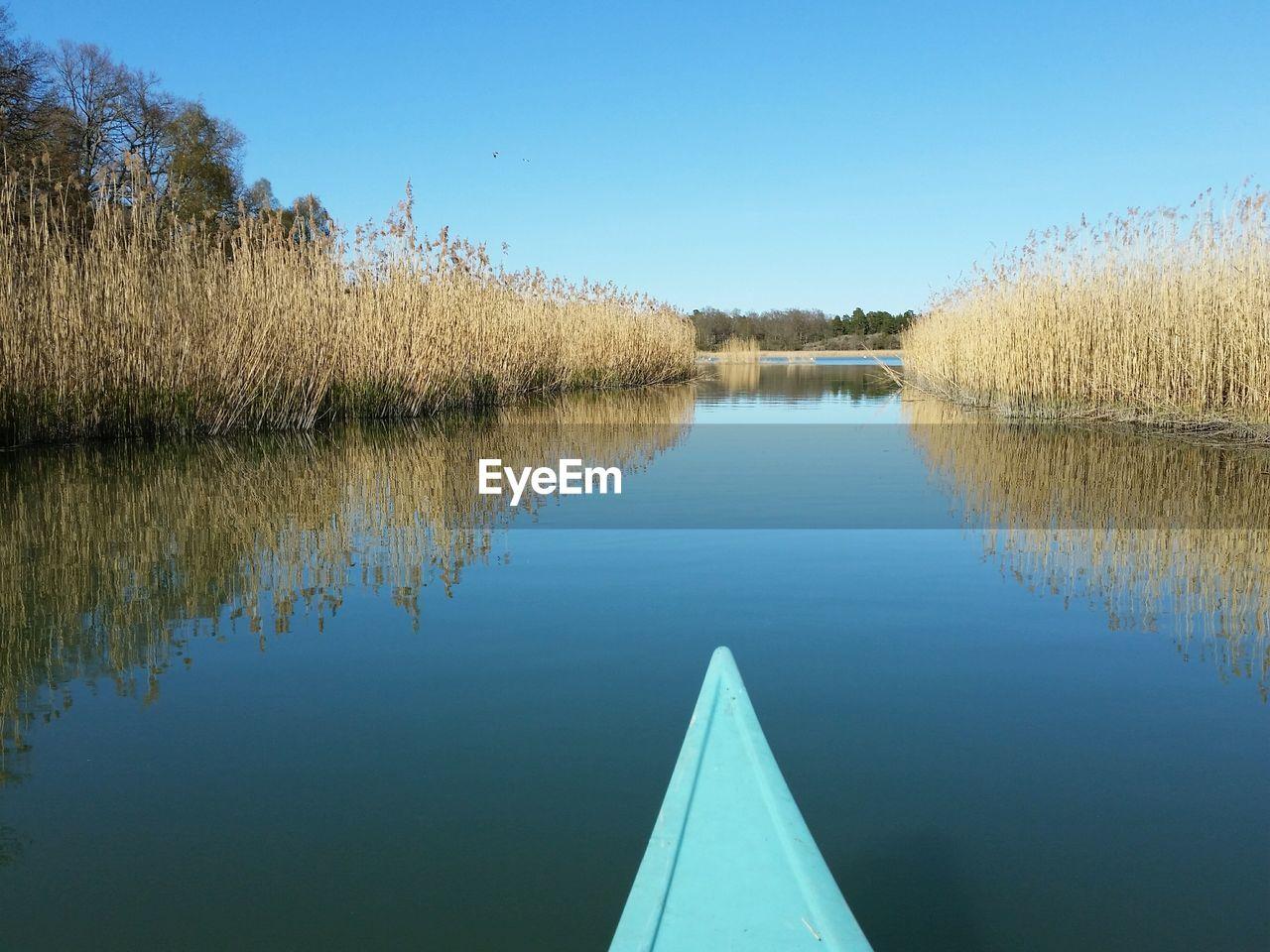 Cropped Image Of Canoe At Lake