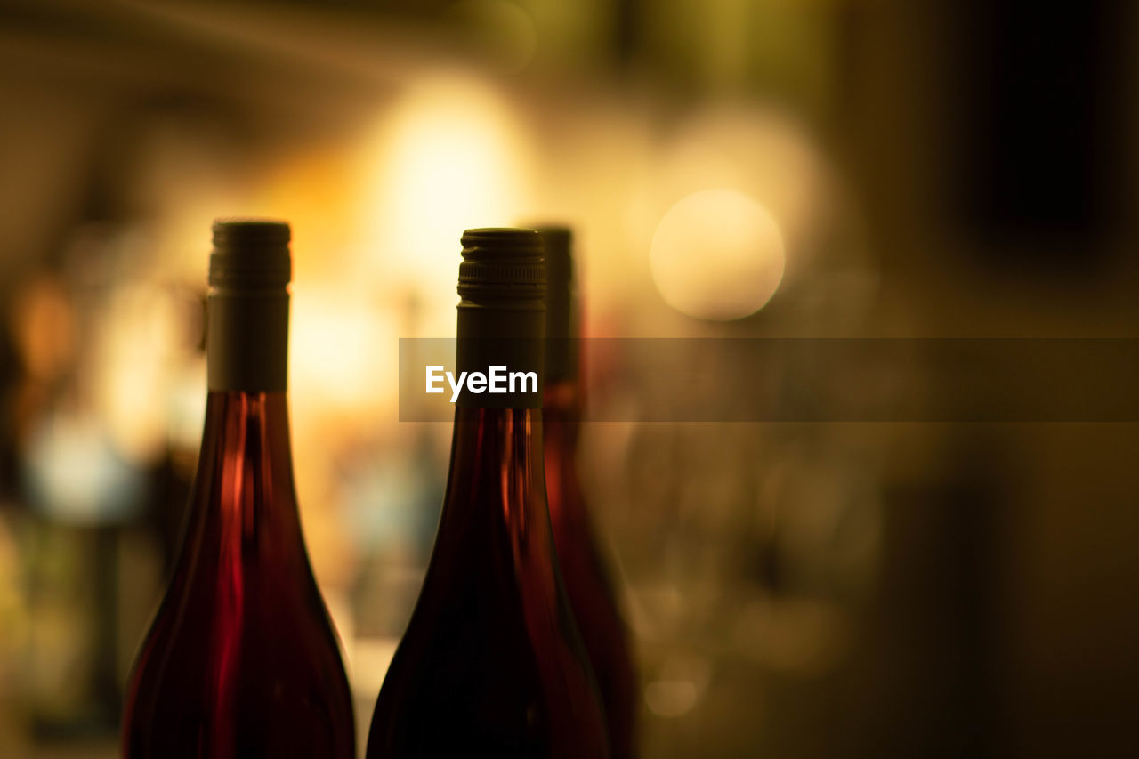 bottle, refreshment, focus on foreground, alcohol, drink, container, glass - material, close-up, indoors, wine bottle, food and drink, no people, wine, selective focus, still life, transparent, glass, beer bottle, champagne, cork - stopper, luxury