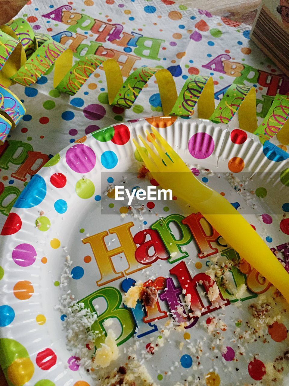 Elevated view of plate and fork after birthday party