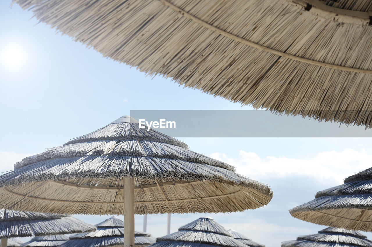 roof, thatched roof, sky, umbrella, parasol, nature, day, protection, sunshade, security, low angle view, beach umbrella, no people, sunlight, cloud - sky, outdoors, beauty in nature, shade, beach