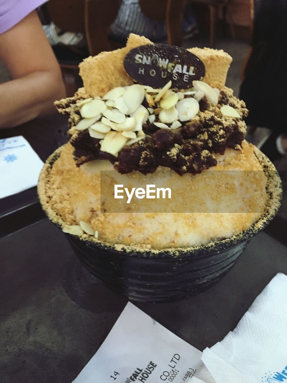 food and drink, food, indulgence, sweet food, freshness, dessert, ready-to-eat, temptation, real people, one person, unhealthy eating, indoors, cake, text, serving size, plate, human hand, holding, close-up, ice cream, human body part, day, people
