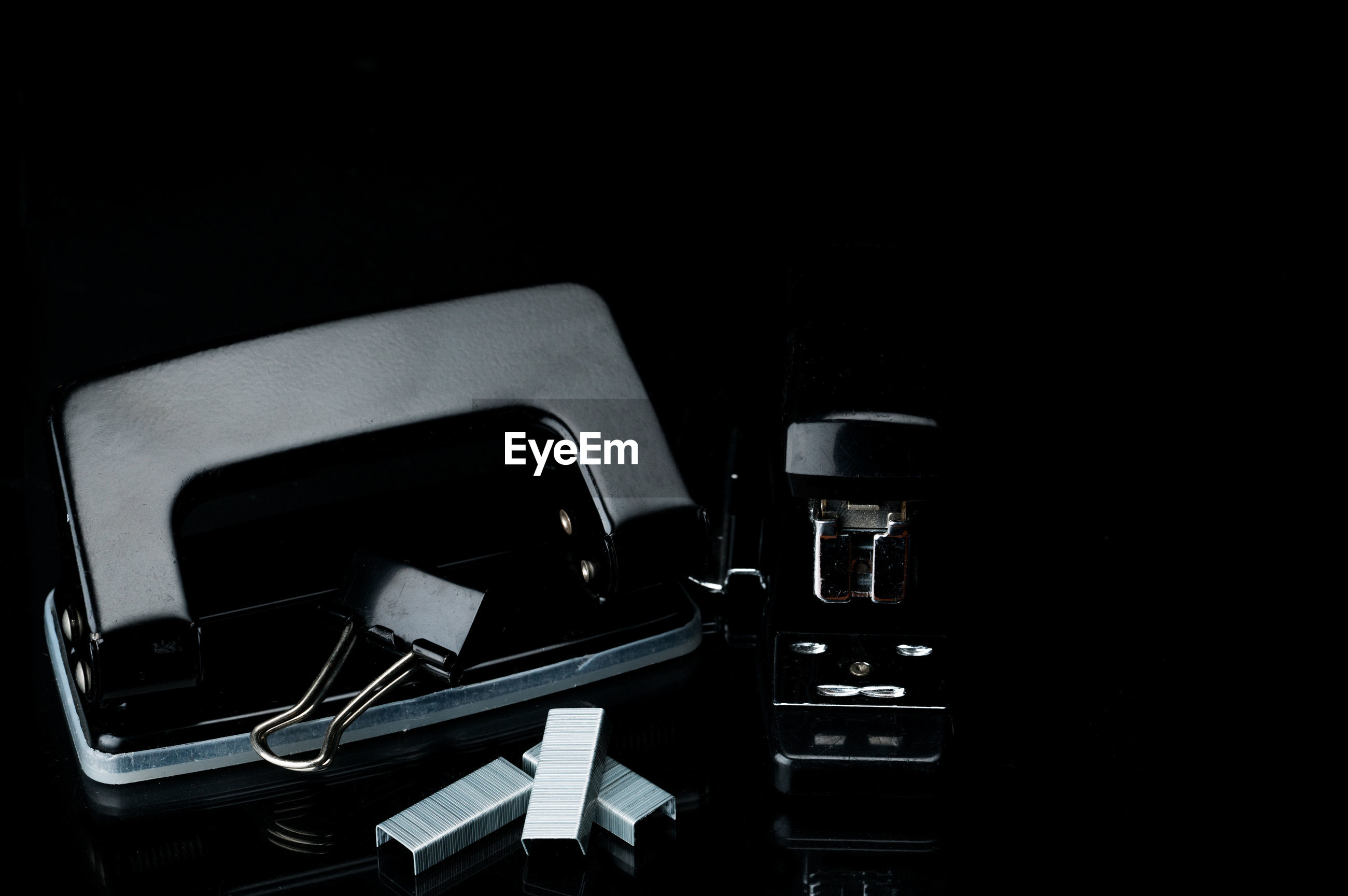 High angle view of equipment on table against black background