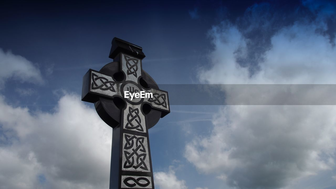 cloud - sky, sky, low angle view, day, text, no people, outdoors, communication, cross, nature