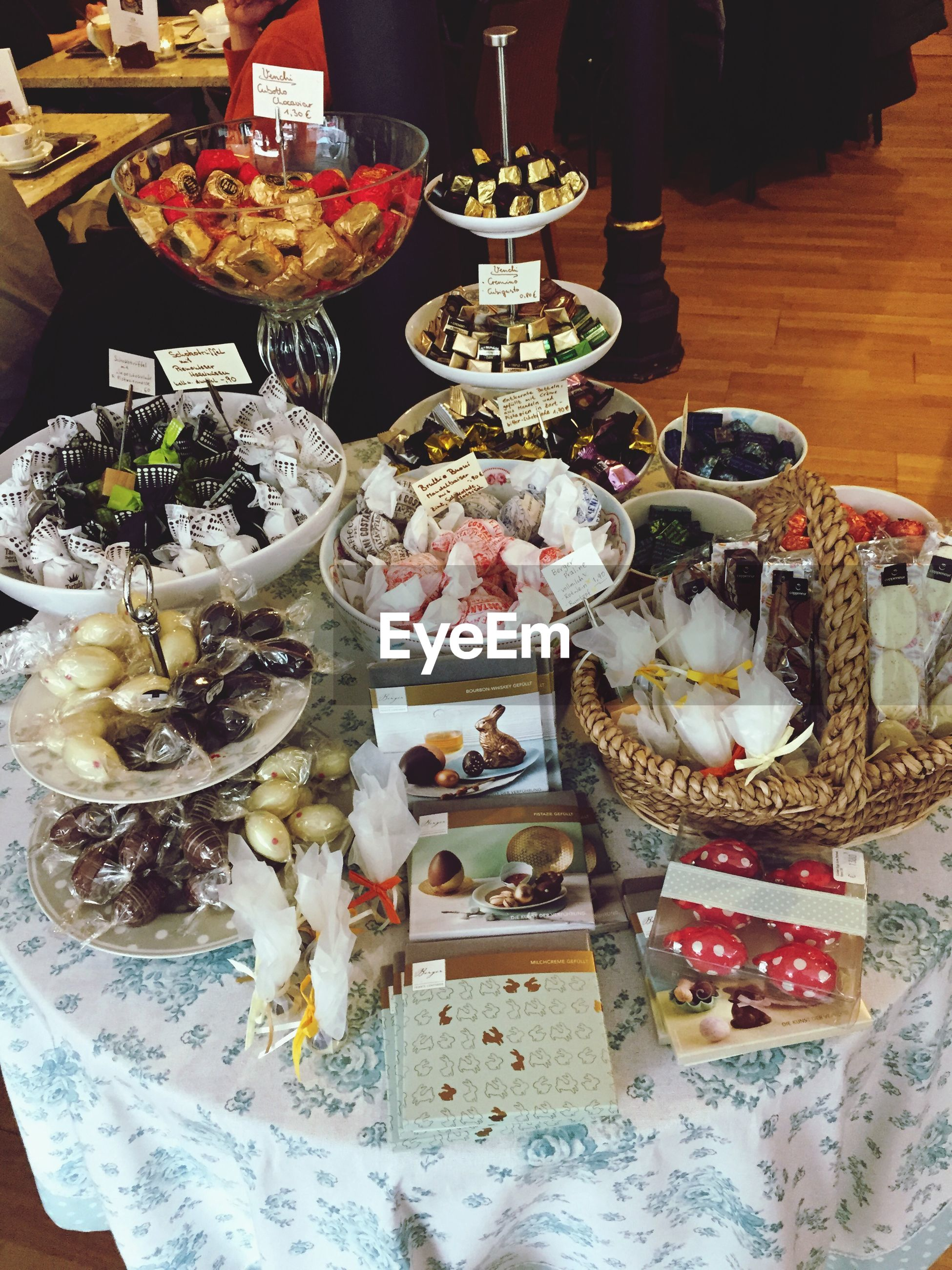 indoors, food and drink, food, table, variation, still life, freshness, plate, restaurant, ready-to-eat, choice, high angle view, indulgence, arrangement, large group of objects, sweet food, healthy eating, abundance, drinking glass, retail