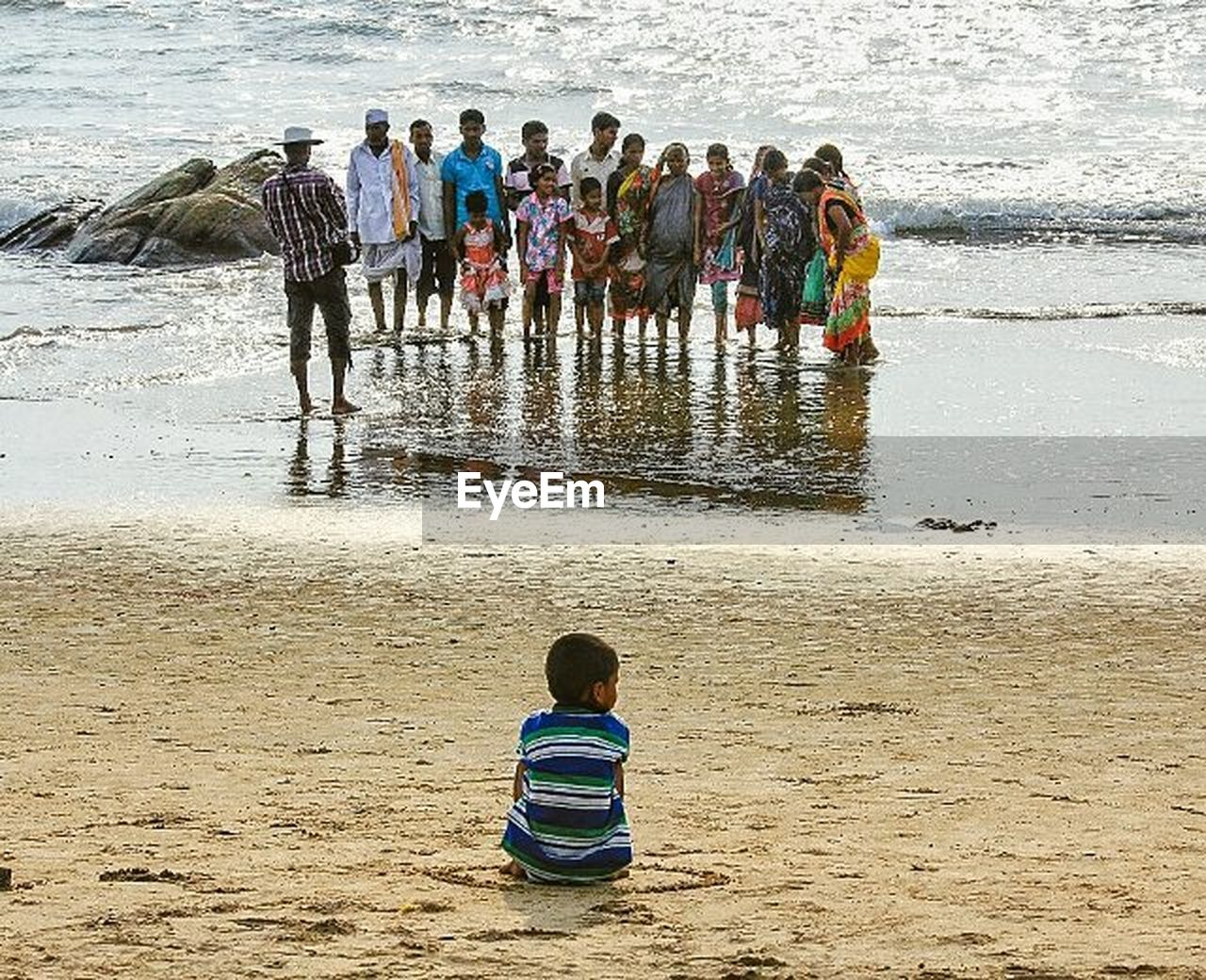 beach, sand, large group of people, water, rear view, boys, sea, leisure activity, childhood, day, full length, outdoors, nature, people, sand pail and shovel, adult