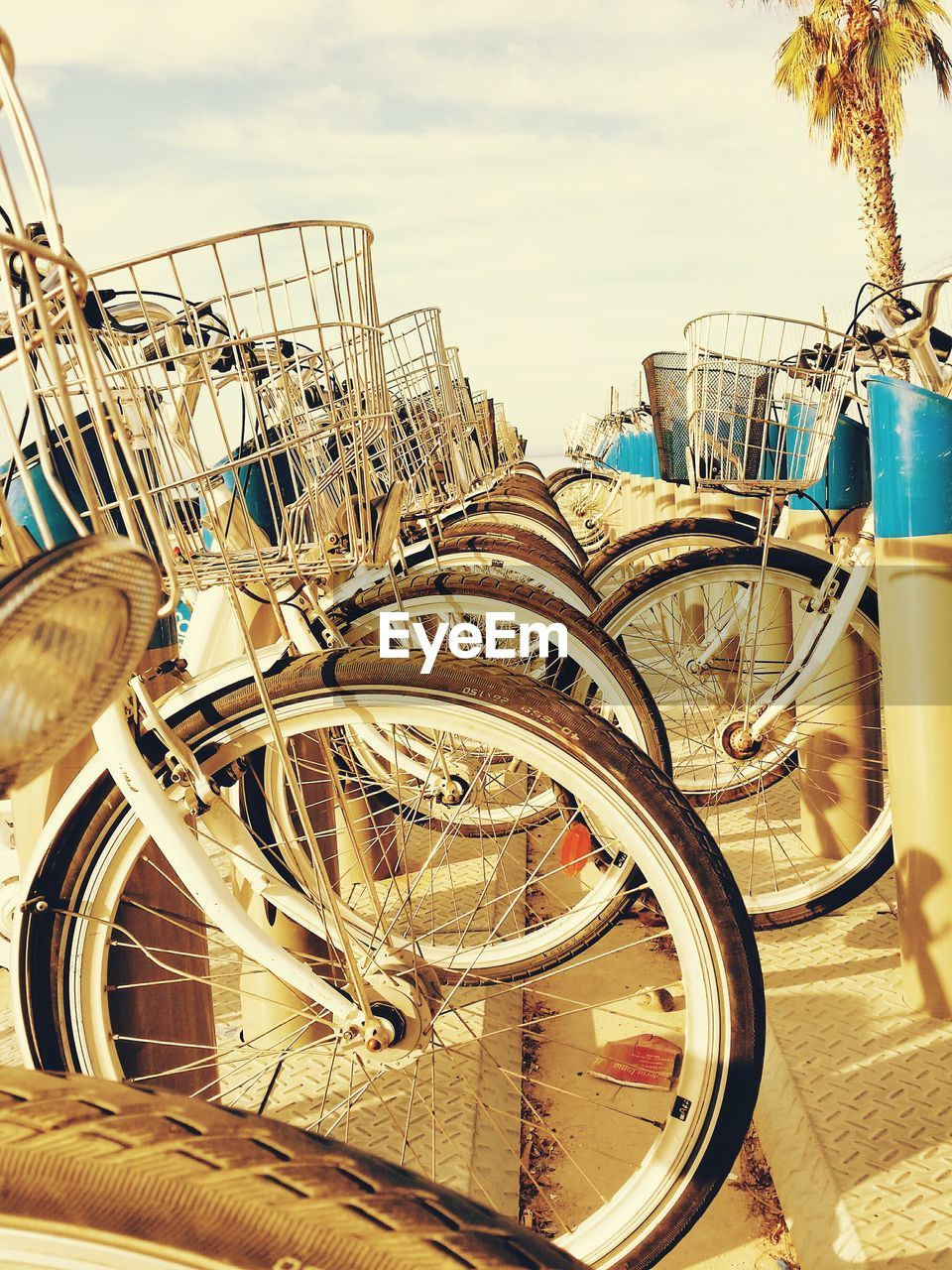 Cropped bicycles parked at stand