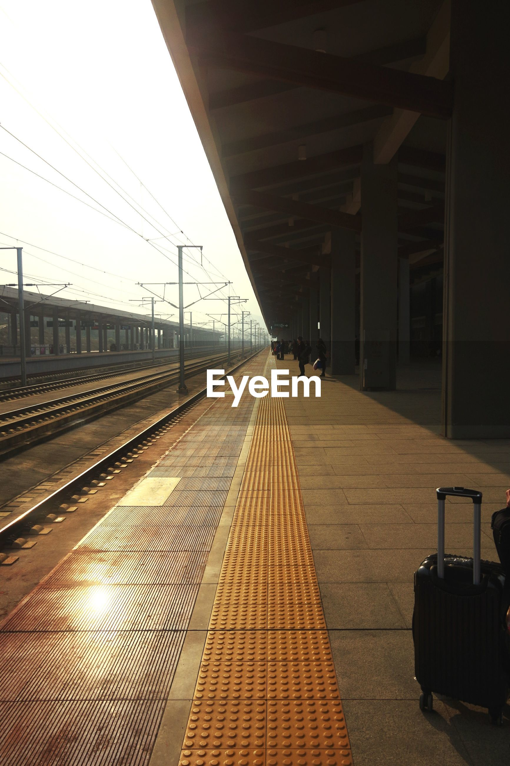 the way forward, diminishing perspective, transportation, vanishing point, railroad track, built structure, architecture, long, rail transportation, empty, railroad station platform, connection, railroad station, sunlight, sky, clear sky, sunset, building exterior, indoors, no people
