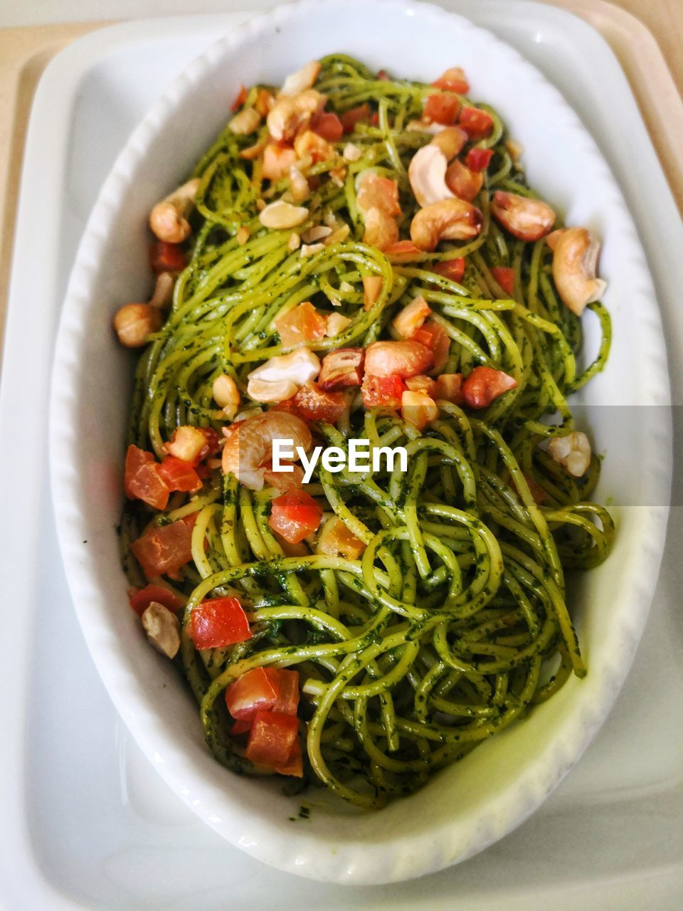 food and drink, food, healthy eating, freshness, wellbeing, vegetable, close-up, still life, ready-to-eat, indoors, plate, no people, italian food, green color, pasta, bowl, directly above, serving size, high angle view, fruit, garnish, spaghetti, vegetarian food, arugula