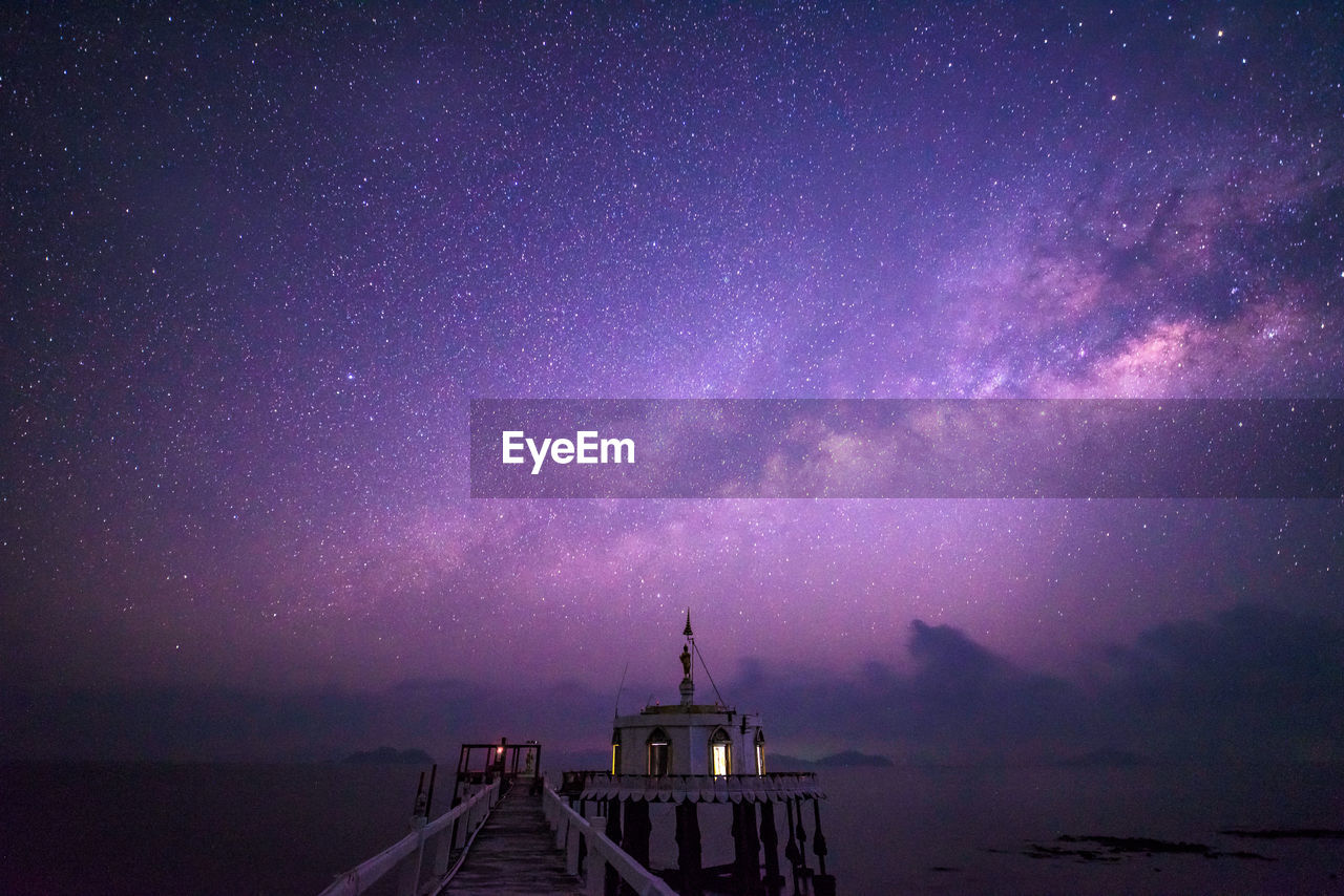 Pier Over Sea Against Milky Way At Night