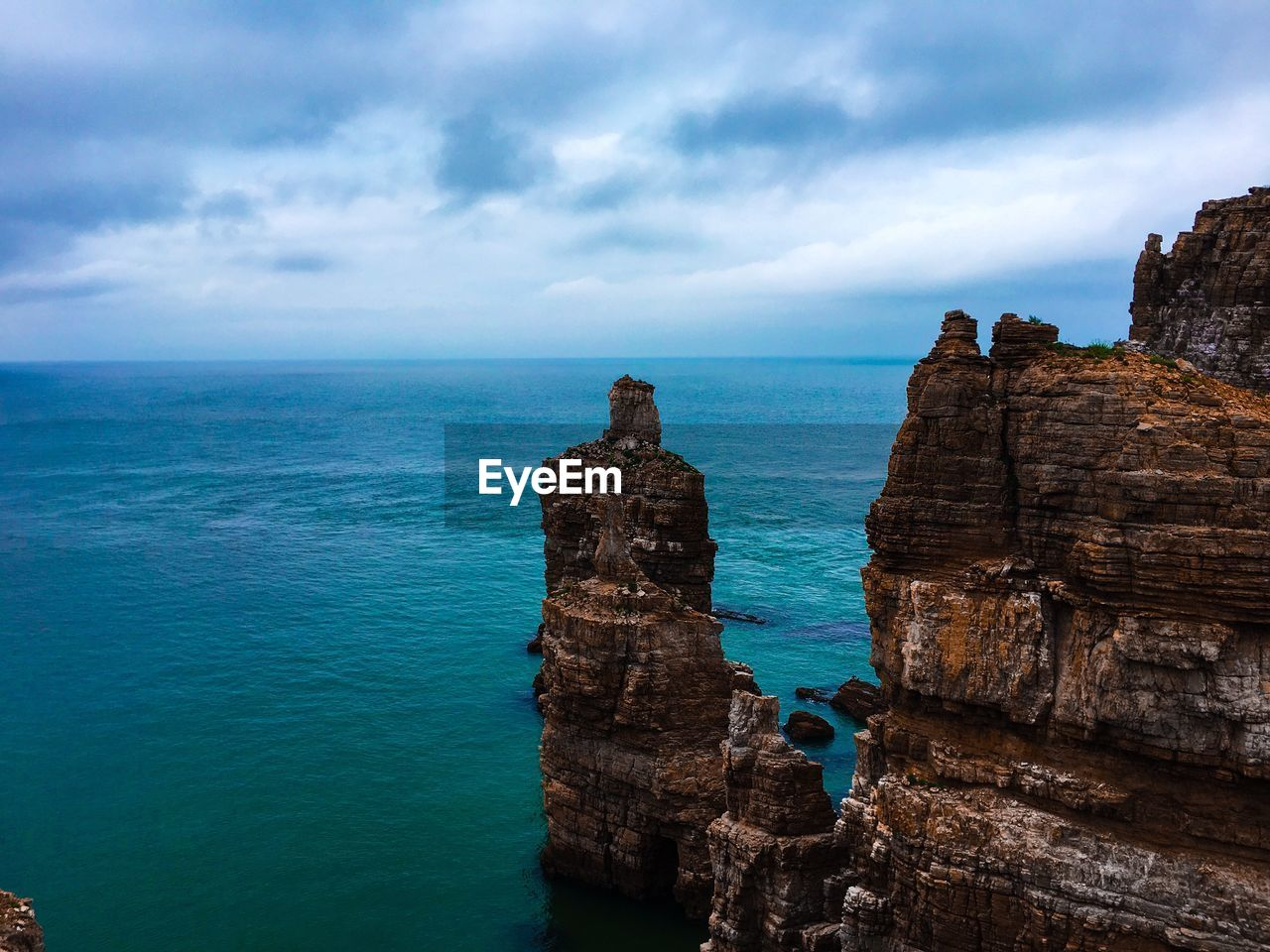 sea, sky, water, cloud - sky, horizon over water, scenics - nature, horizon, beauty in nature, tranquility, tranquil scene, nature, rock, no people, land, solid, rock - object, non-urban scene, rock formation, day, outdoors, stack rock, eroded