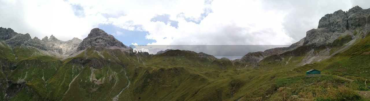 mountain, scenics - nature, beauty in nature, sky, tranquil scene, mountain range, tranquility, landscape, environment, cloud - sky, panoramic, nature, non-urban scene, day, plant, activity, no people, land, idyllic, rock, outdoors, mountain peak, formation
