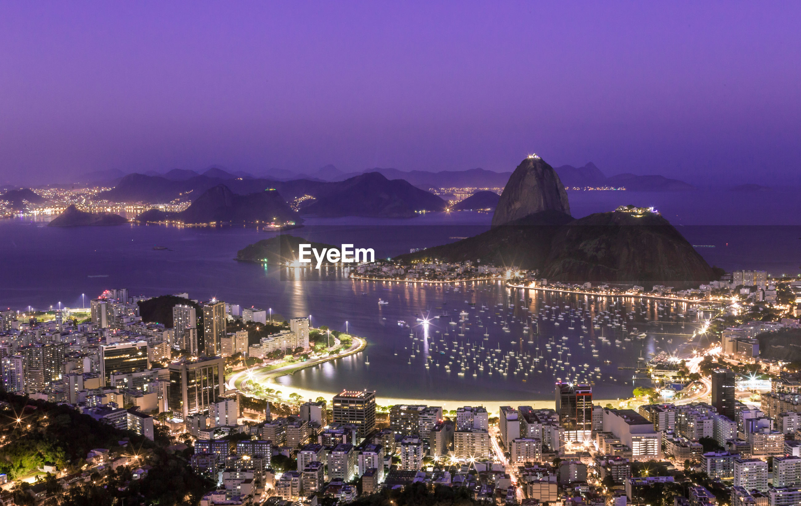 High angle view of sugarloaf mountain  lit up at night. rio de janeiro