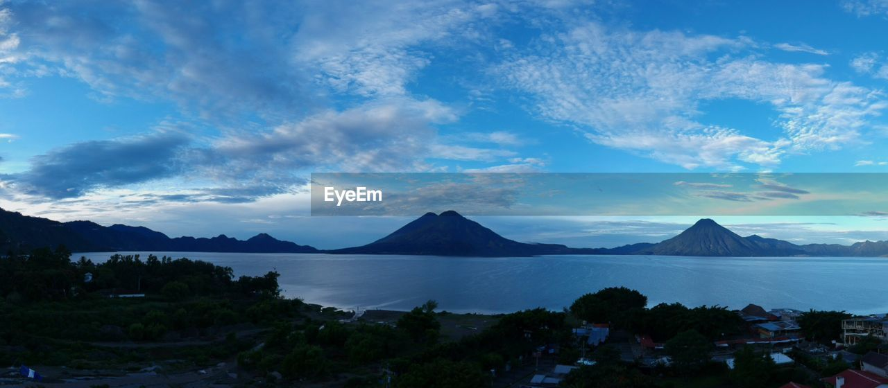 sky, mountain, cloud - sky, water, beauty in nature, scenics - nature, tranquility, tranquil scene, no people, nature, tree, blue, plant, landscape, lake, idyllic, mountain range, non-urban scene, environment, outdoors, bay, mountain peak